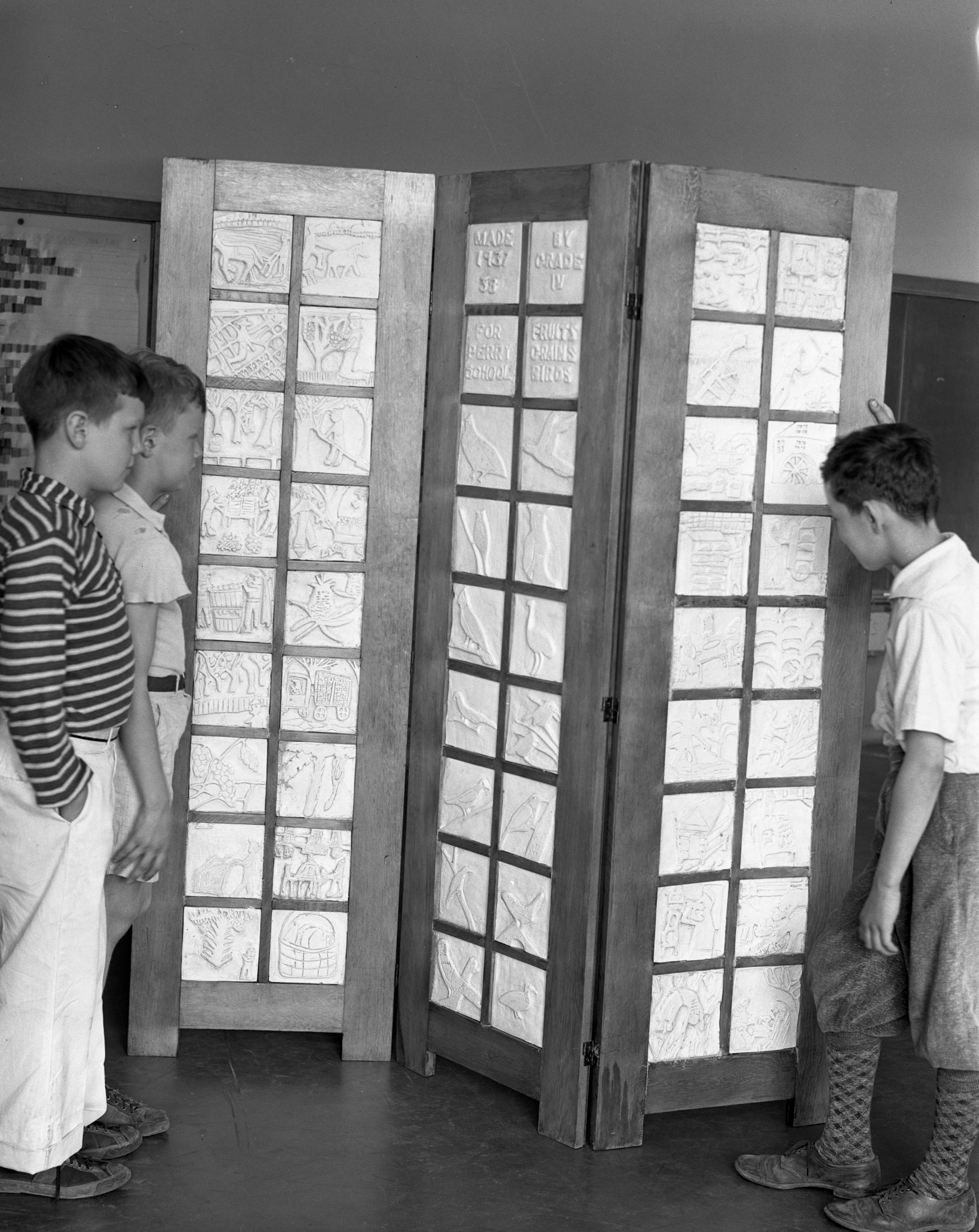 Perry School Fourth Grade Students Howard Beatty, John Dudley and Donald Dildine With Screen of Plaques, June 1938 image