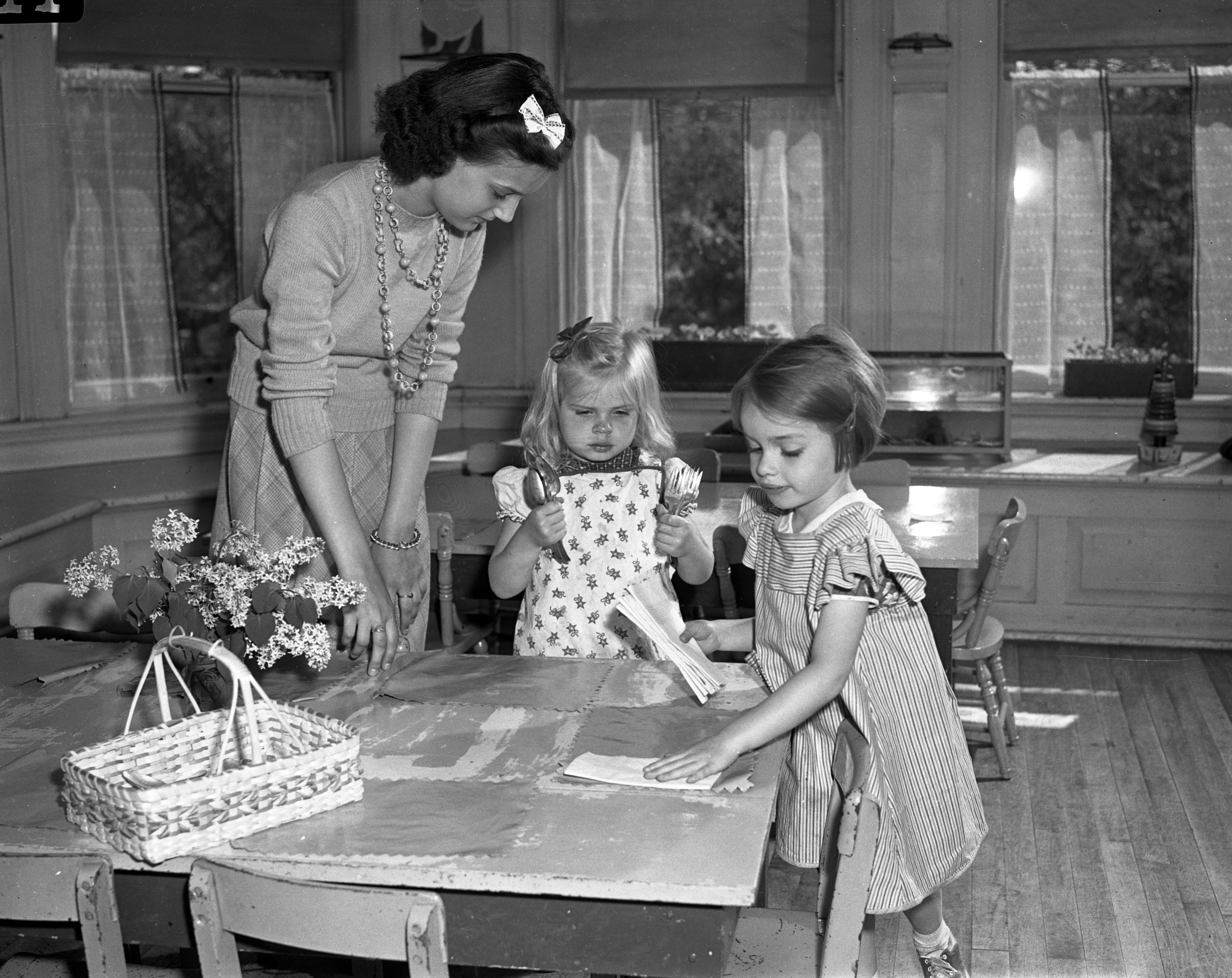Defense Workers' Children Cared for by Girl Reserve at Perry School, May 1942 image