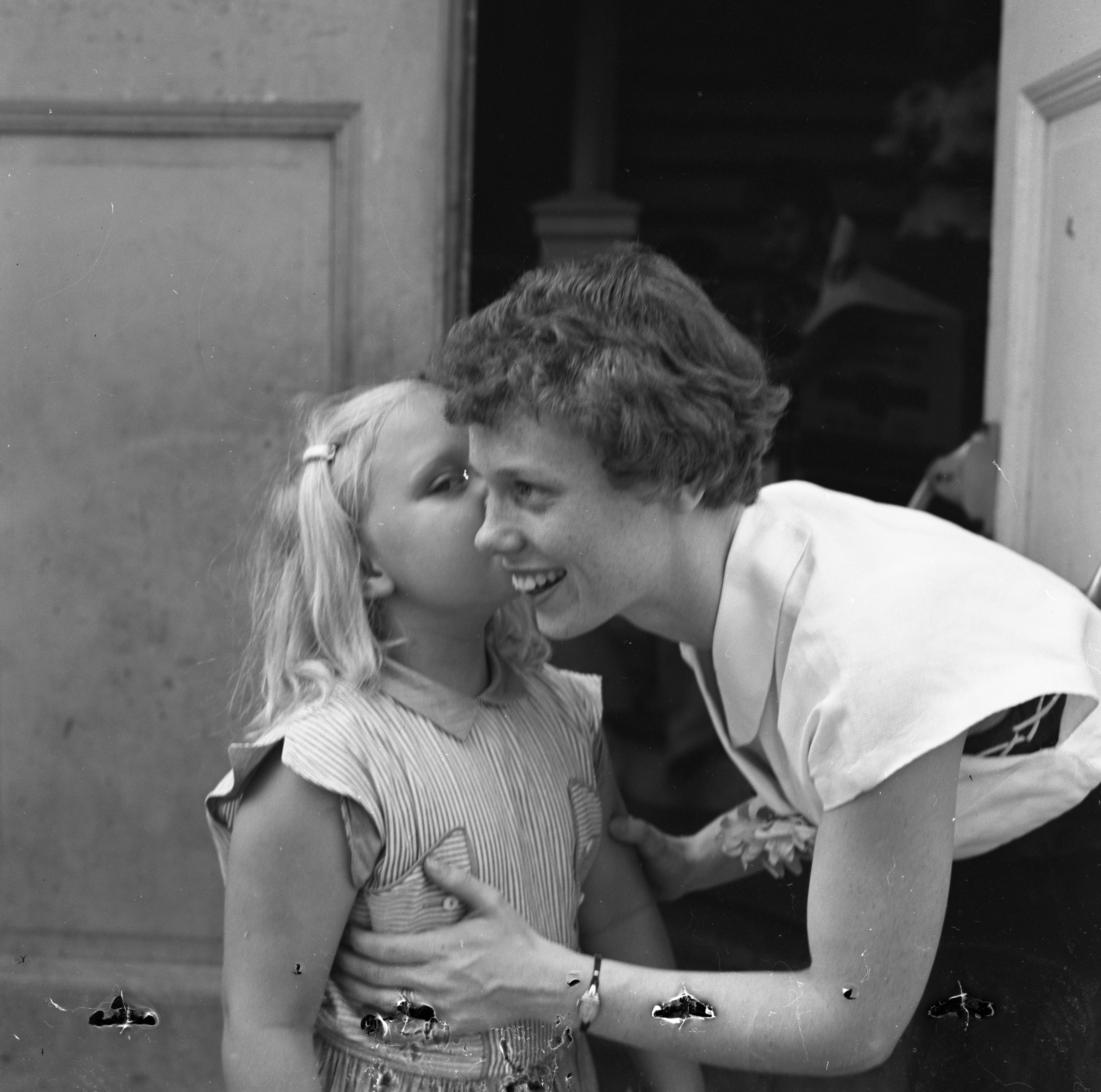 Patricia Winkle Kisses Her Teacher Goodbye On Last Day Of School, June 1954 image