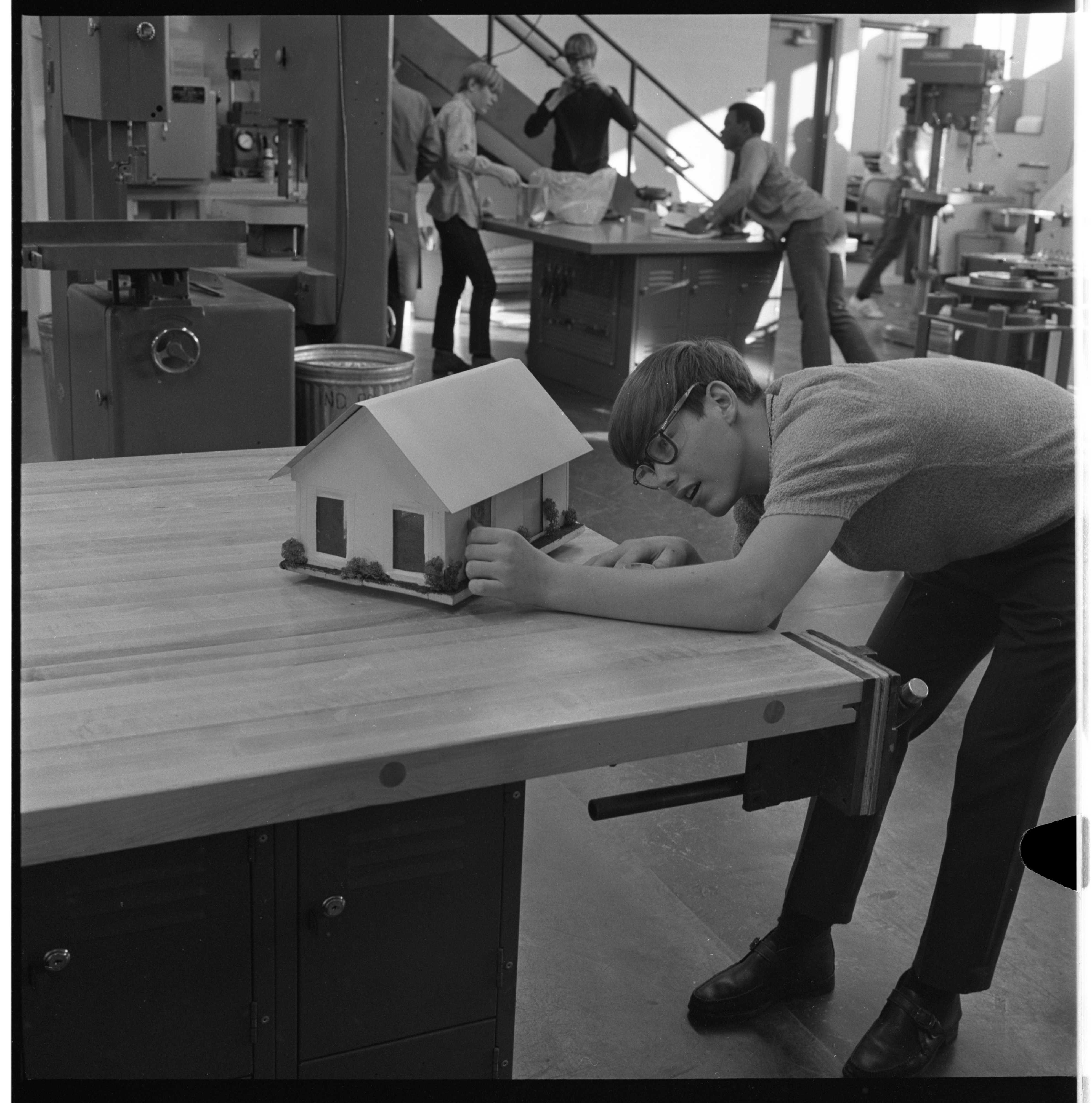 Bill Brushaber Examines The Model He Made In Huron High School's Industrial Processes Class, January 1970 image