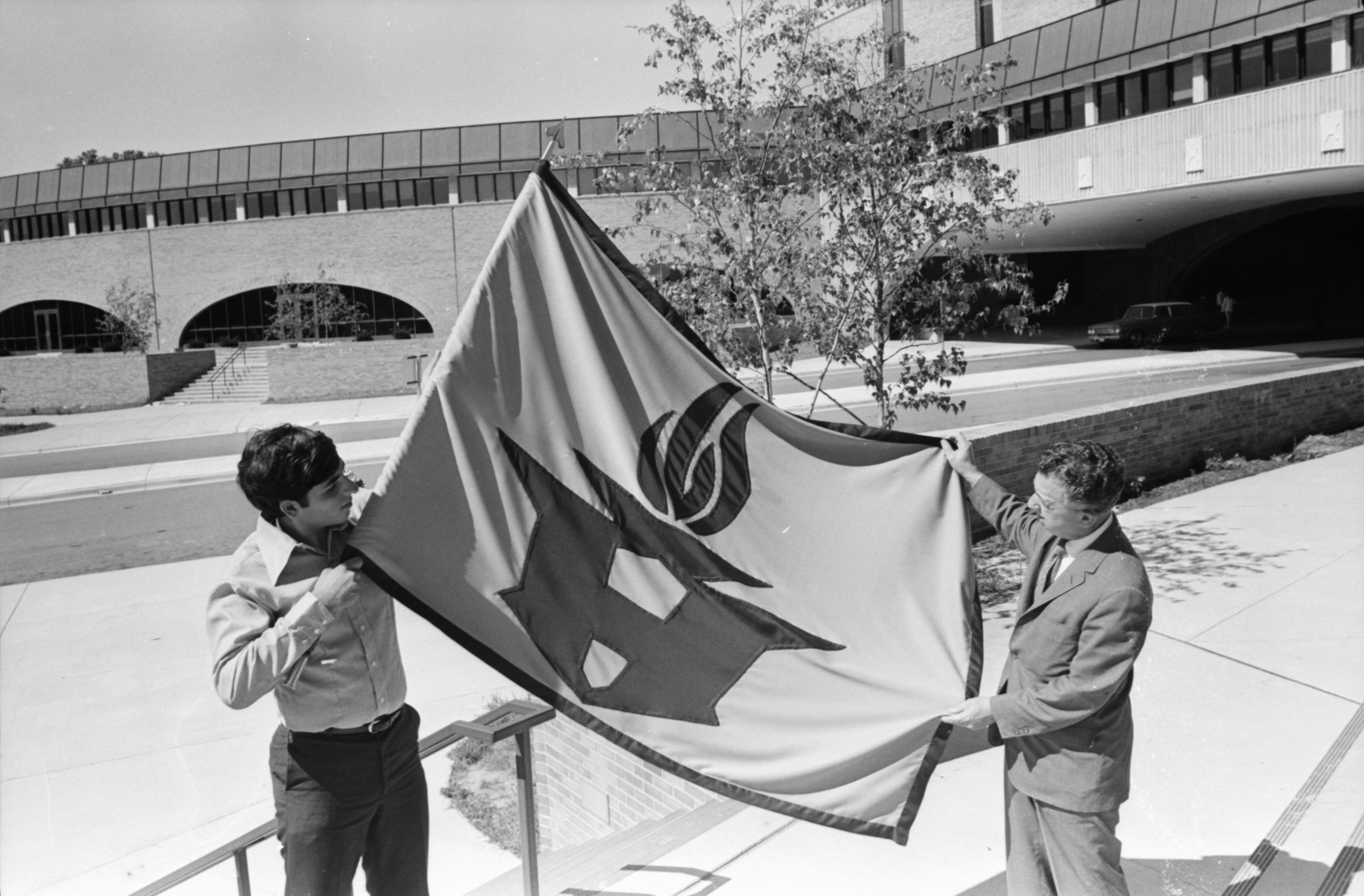 A Student and Faculty Member Hanging the Huron High School's Flag, September 1970 image