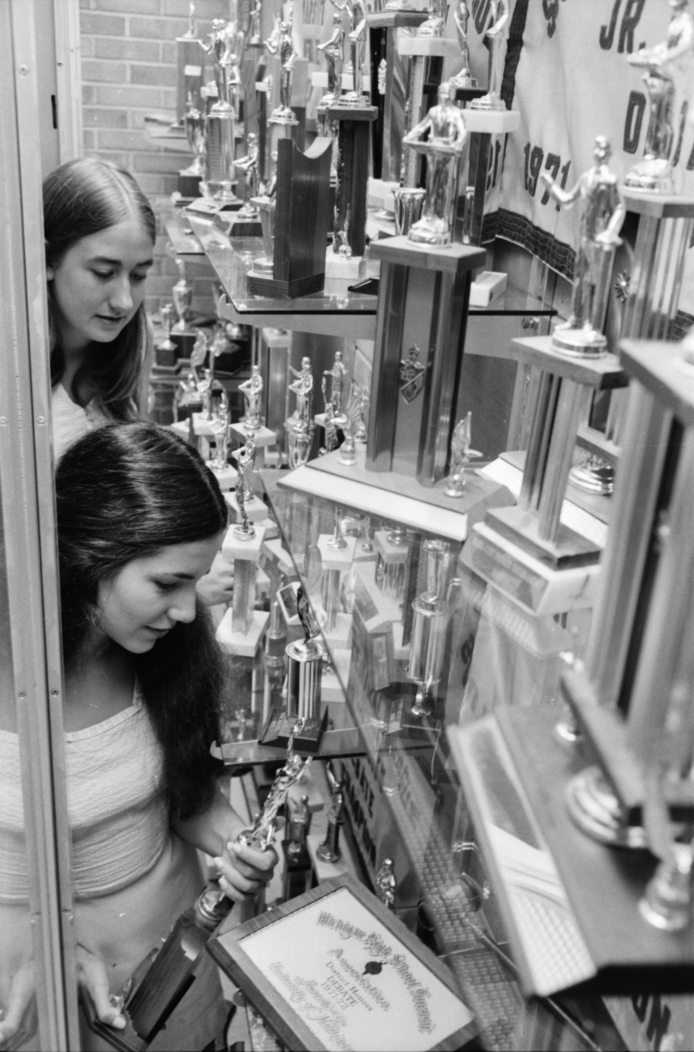 Debby Mueller and Lona Georgopoulos with Huron High Forensics Team Trophies, June 1974 image