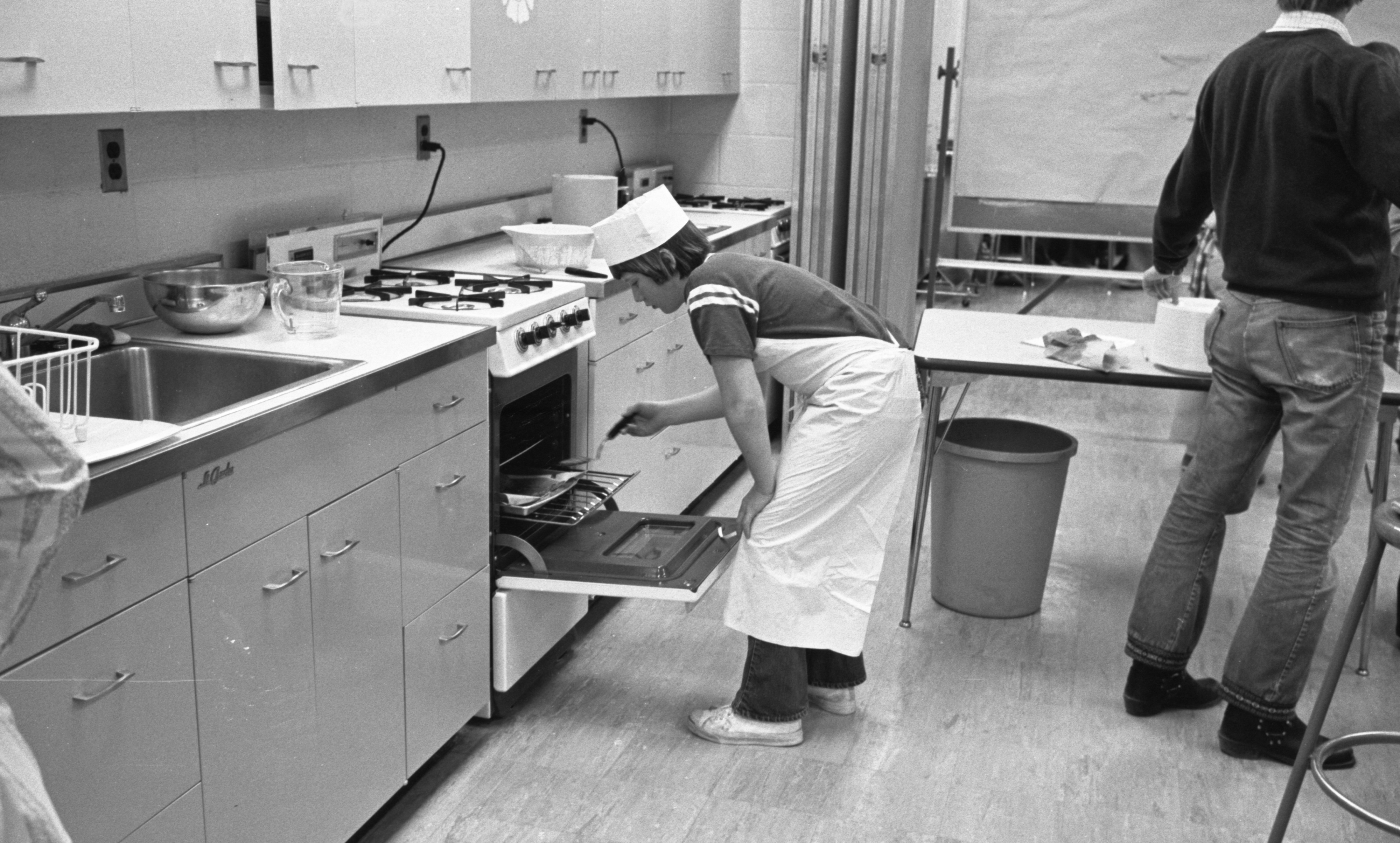 Rick Knorpp Cooks Sausage For The Project Scarlett 'Road Runner Inn' Restaurant, February 1973 image