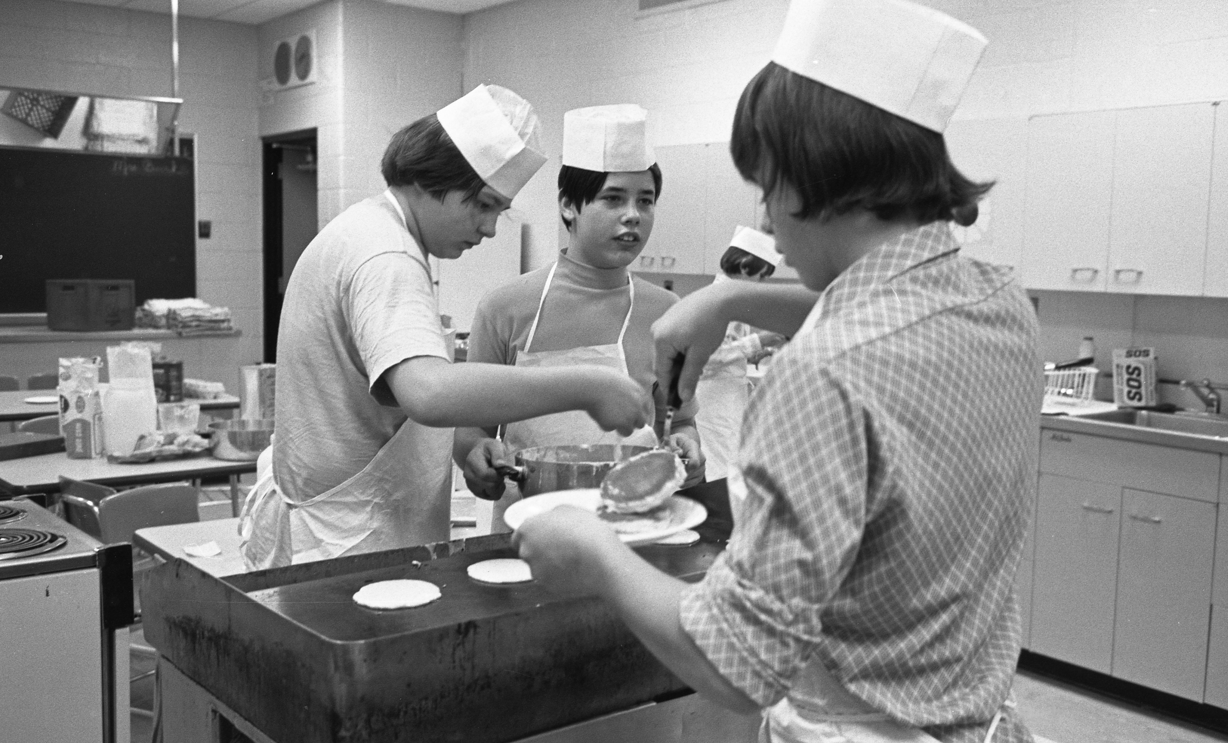 Mark Smalley & Fellow Students Cook Pancakes For The Project Scarlett 'Road Runner Inn' Restaurant, February 1973 image
