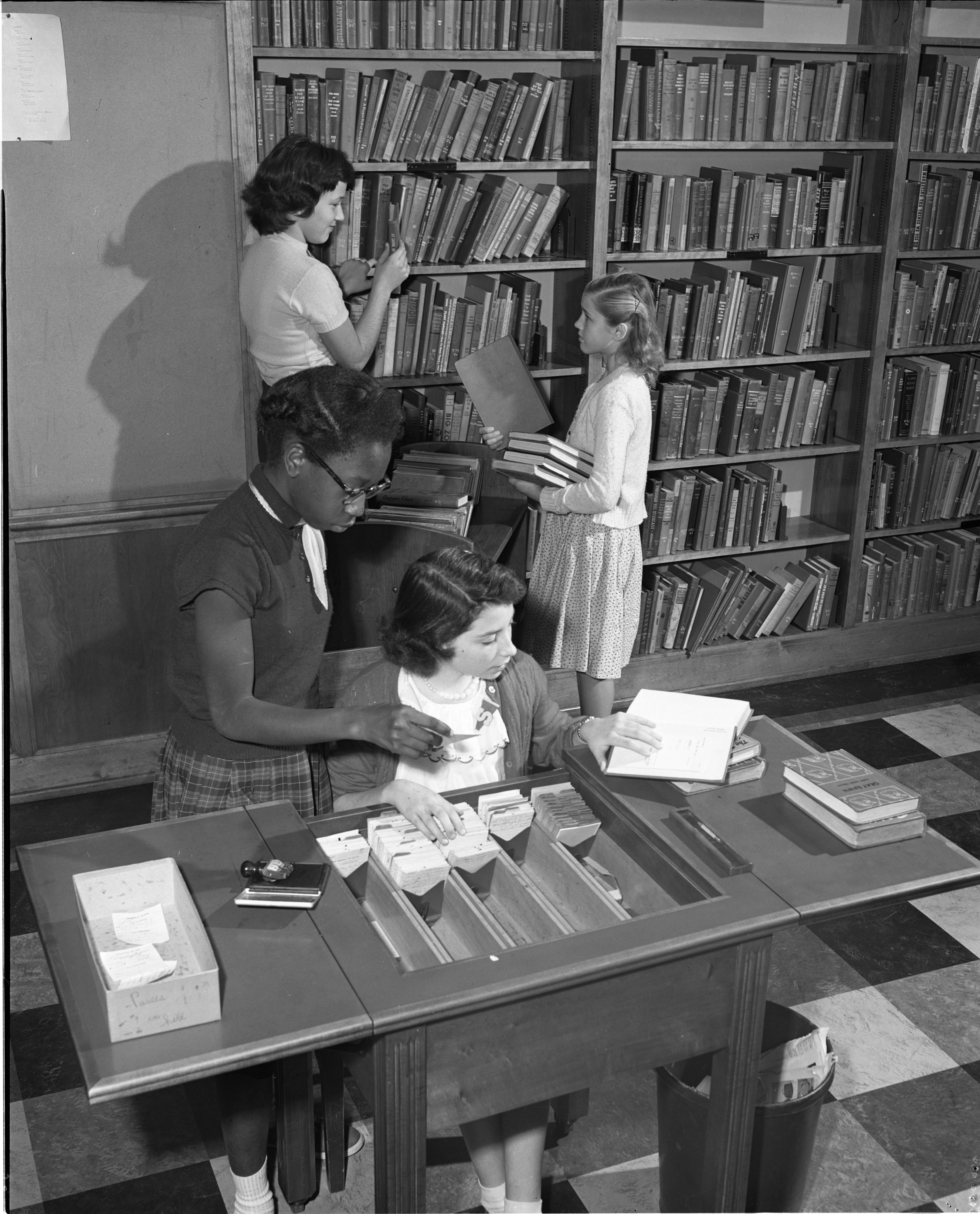 Seventh Grade Library Committee Members Work In The Slauson Junior High Library, October 1953 image