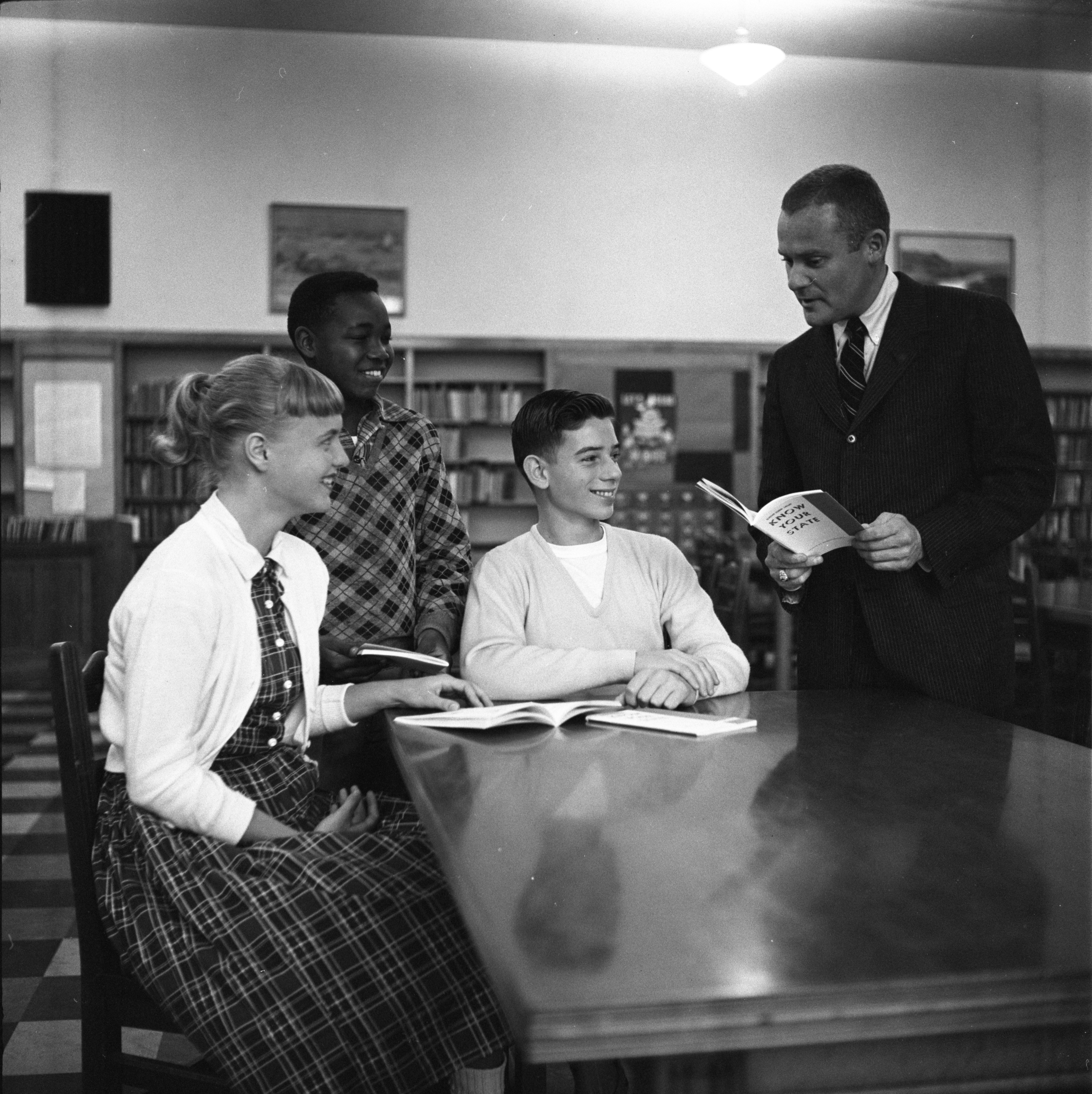 Arthur Markendorf Shows Slauson Students The Latest League of Women Voters Pamphlet, November 1957 image