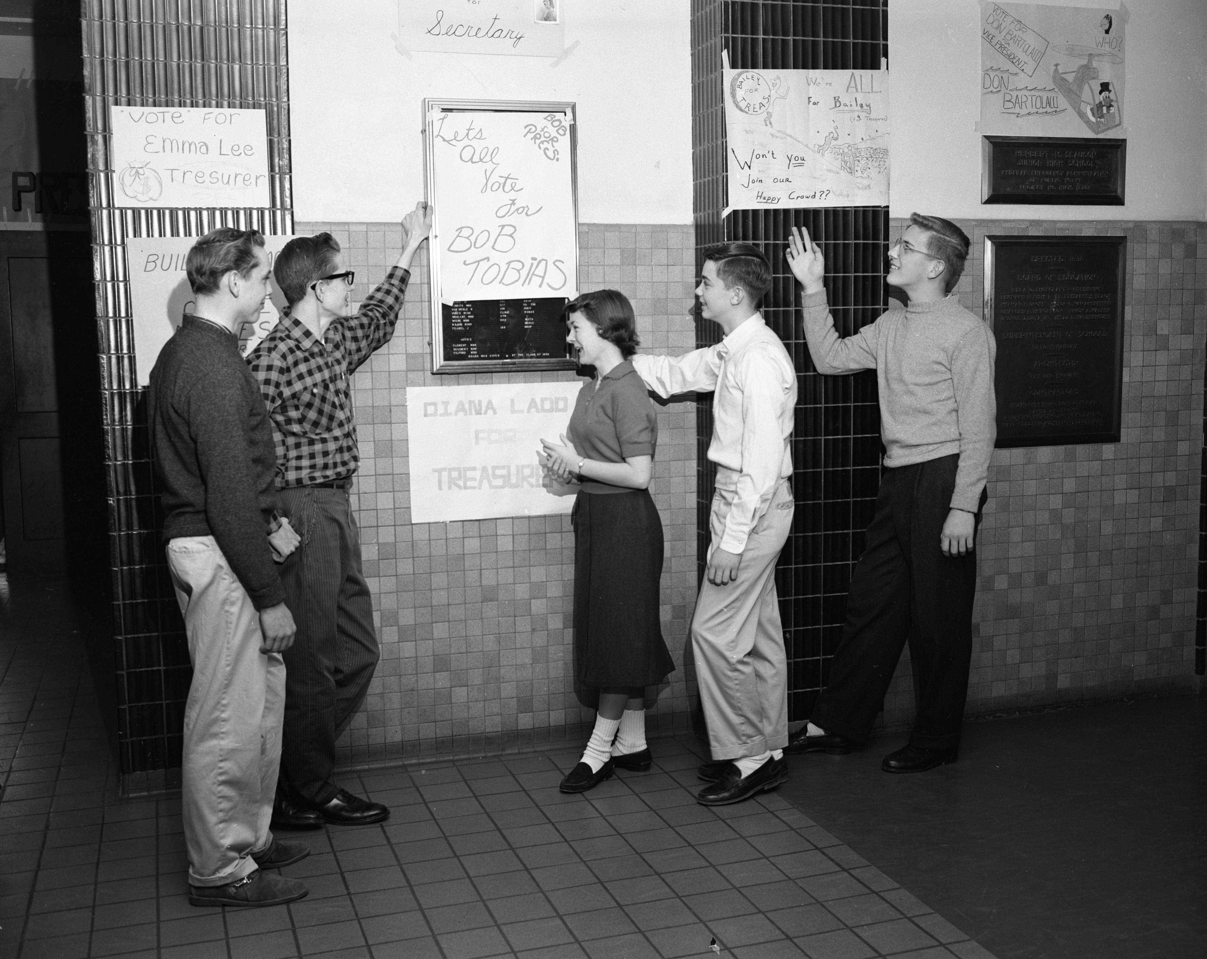 Slauson Junior High School Student Council candidates look at posters, January 1958 image