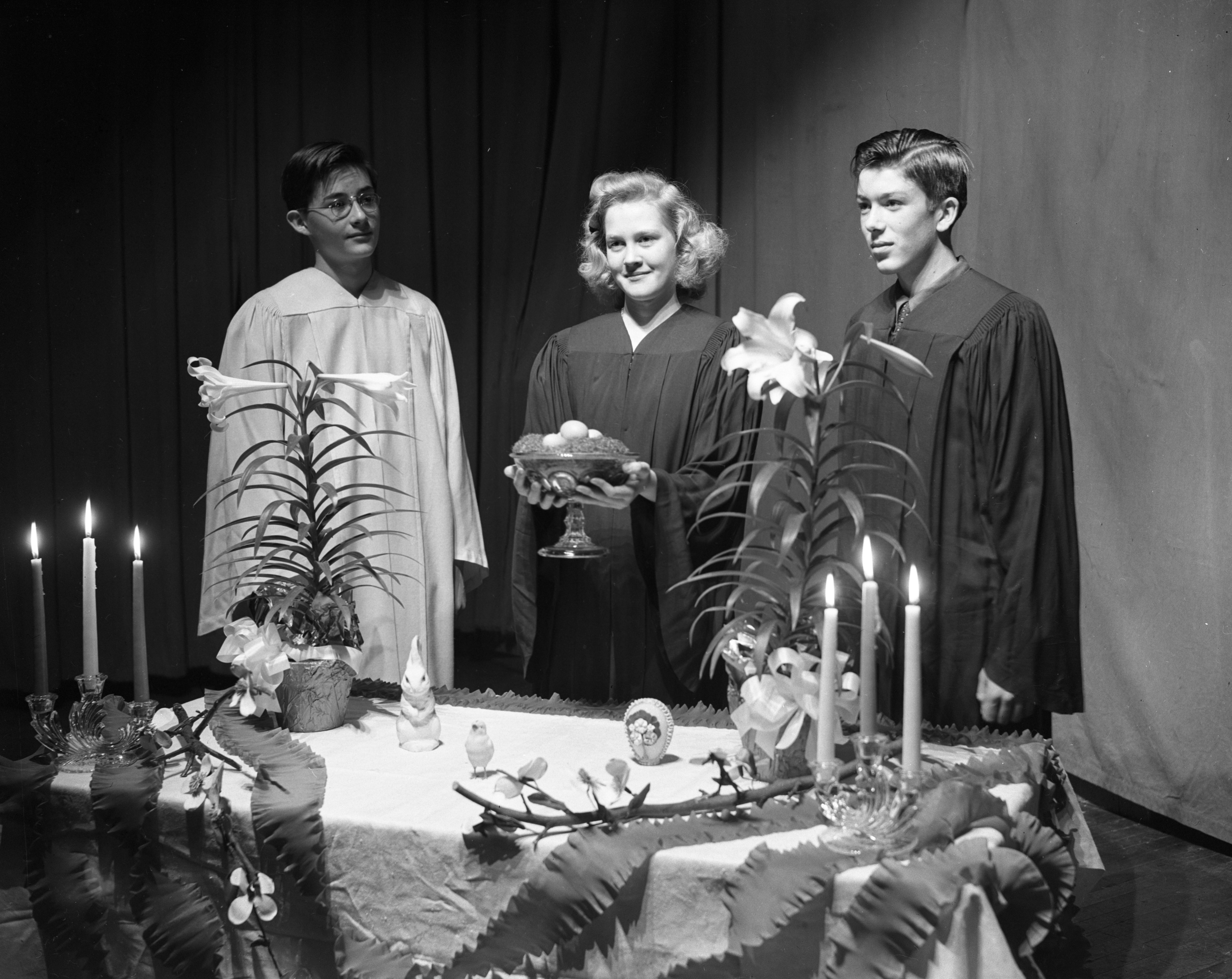 Tappan students Konrad Matthaei, Anne Waterman and William Godfrey explain Easter symbols during school assembly, April 1944 image