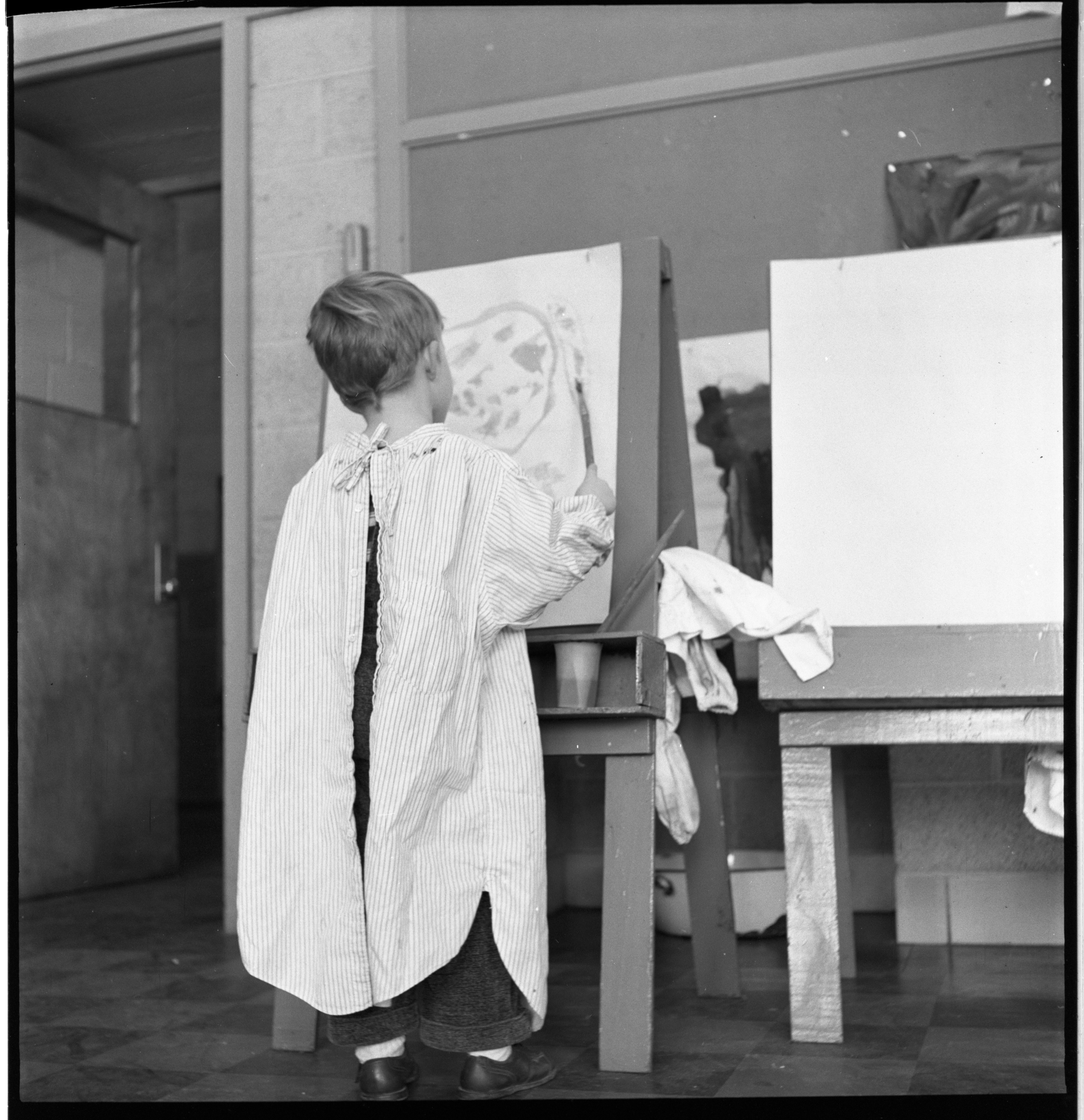 Bruce Wilson Works On A Painting At The Ann Arbor Co-Operative Nursery School, January 1955 image