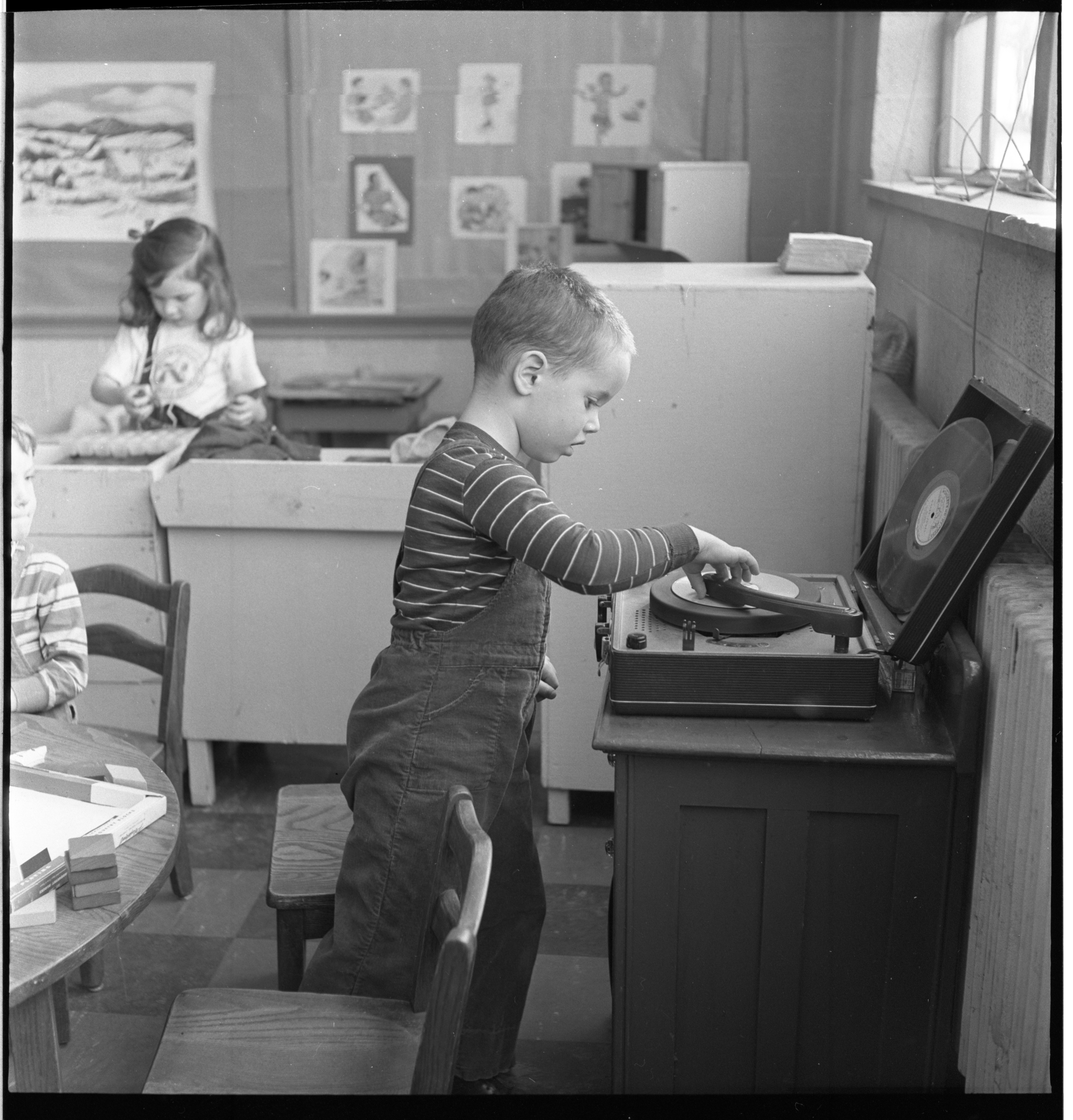 A Child Changes The Music On The Record Player At The Ann Arbor Co-Operative Nursery School, January 1955 image