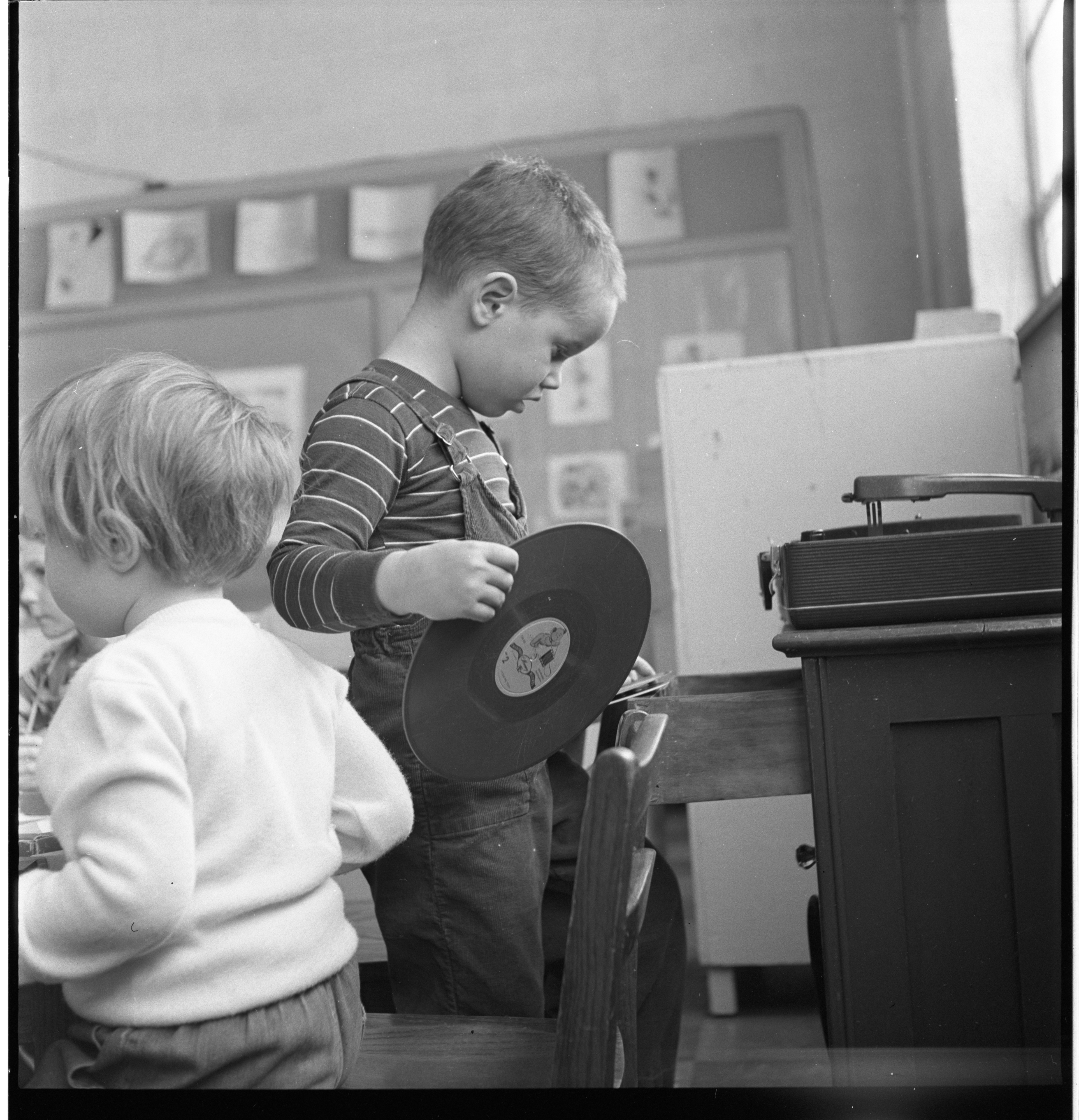 A Child Chooses A Record At The Ann Arbor Co-Operative Nursery School, January 1955 image