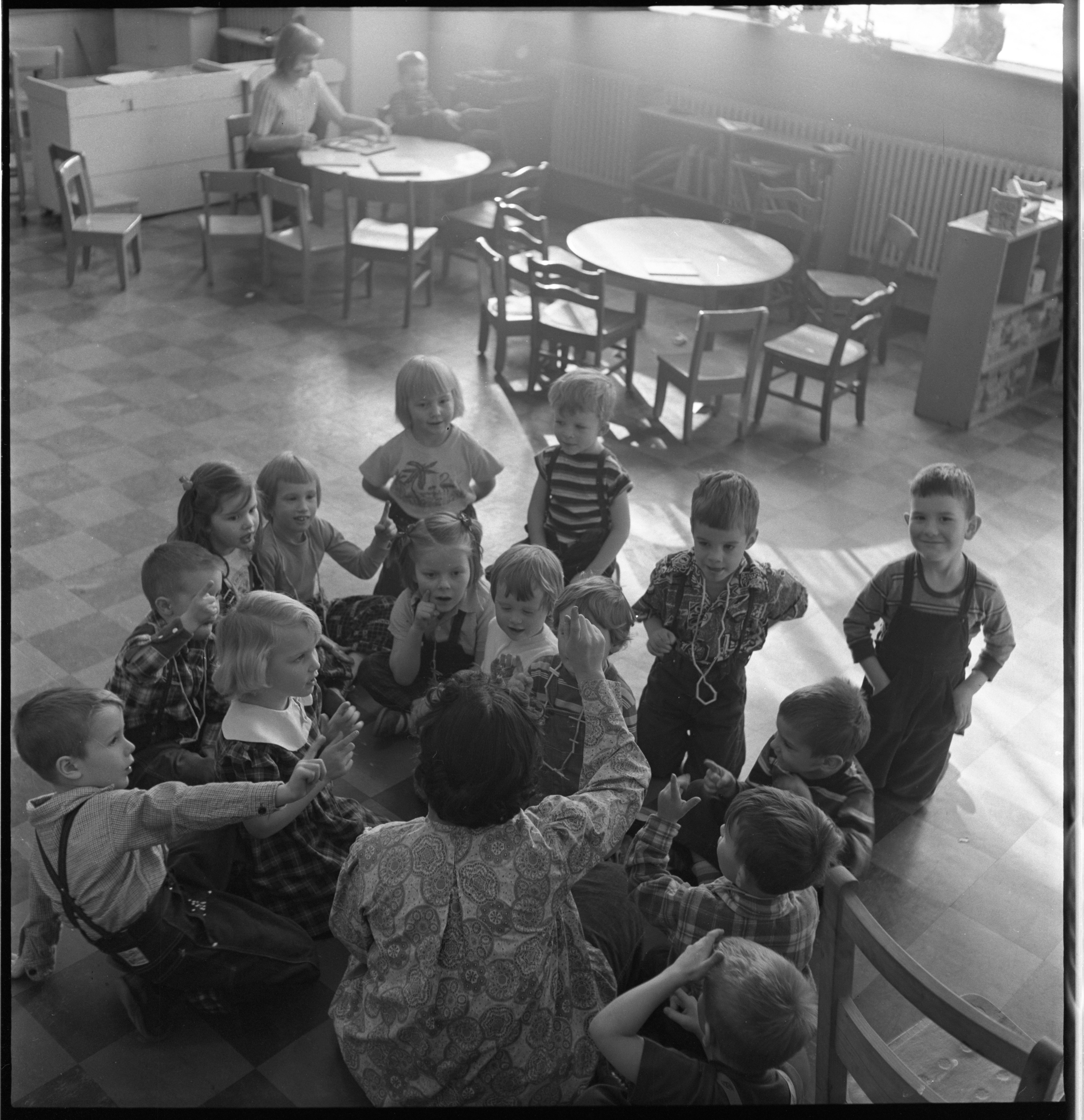 Mrs. Binn Leads A Song At The Ann Arbor Co-Operative Nursery School, January 1955 image