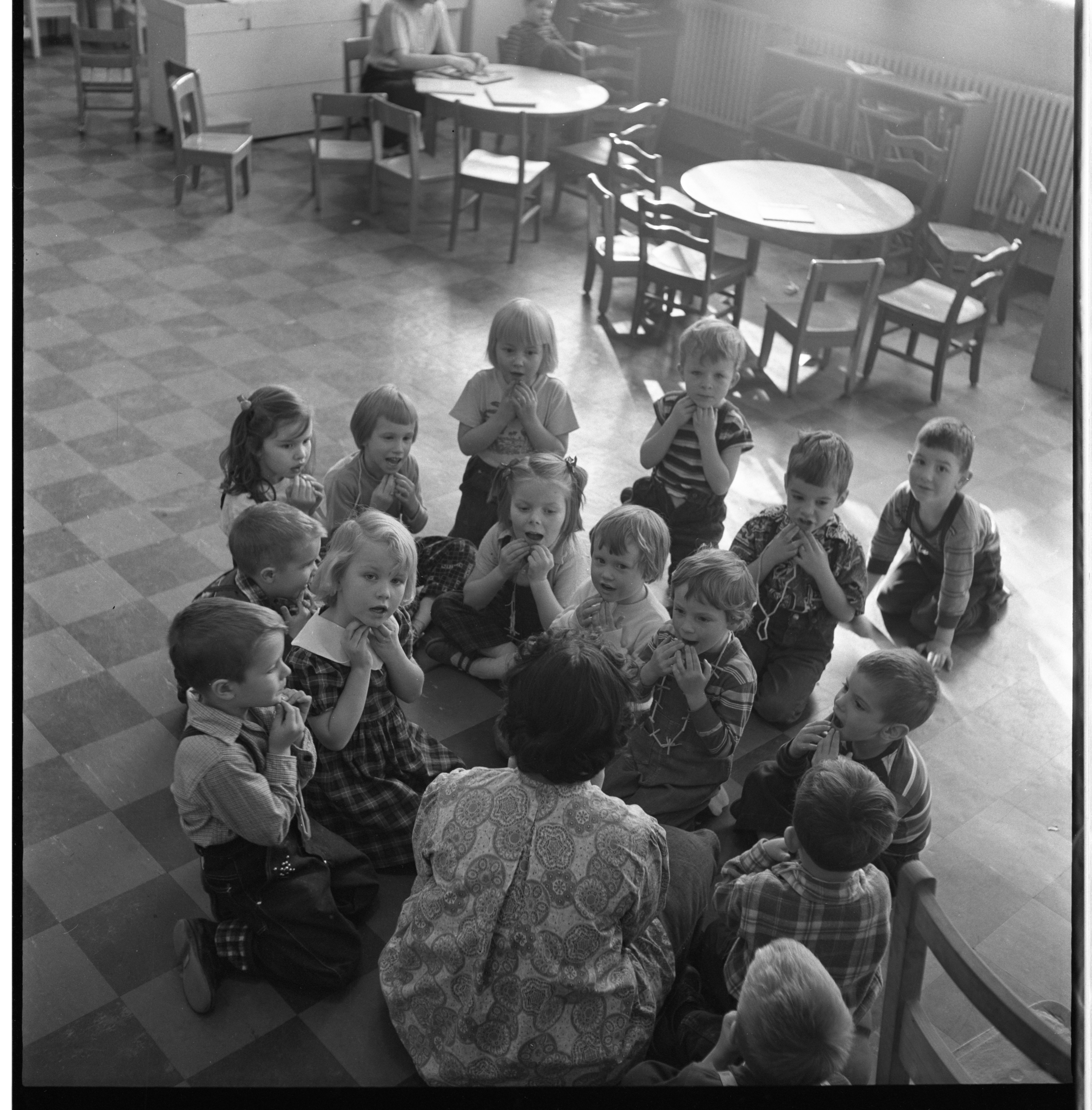 Mrs. Binn Leads Children In A Song At The Ann Arbor Co-Operative Nursery School, January 1955 image