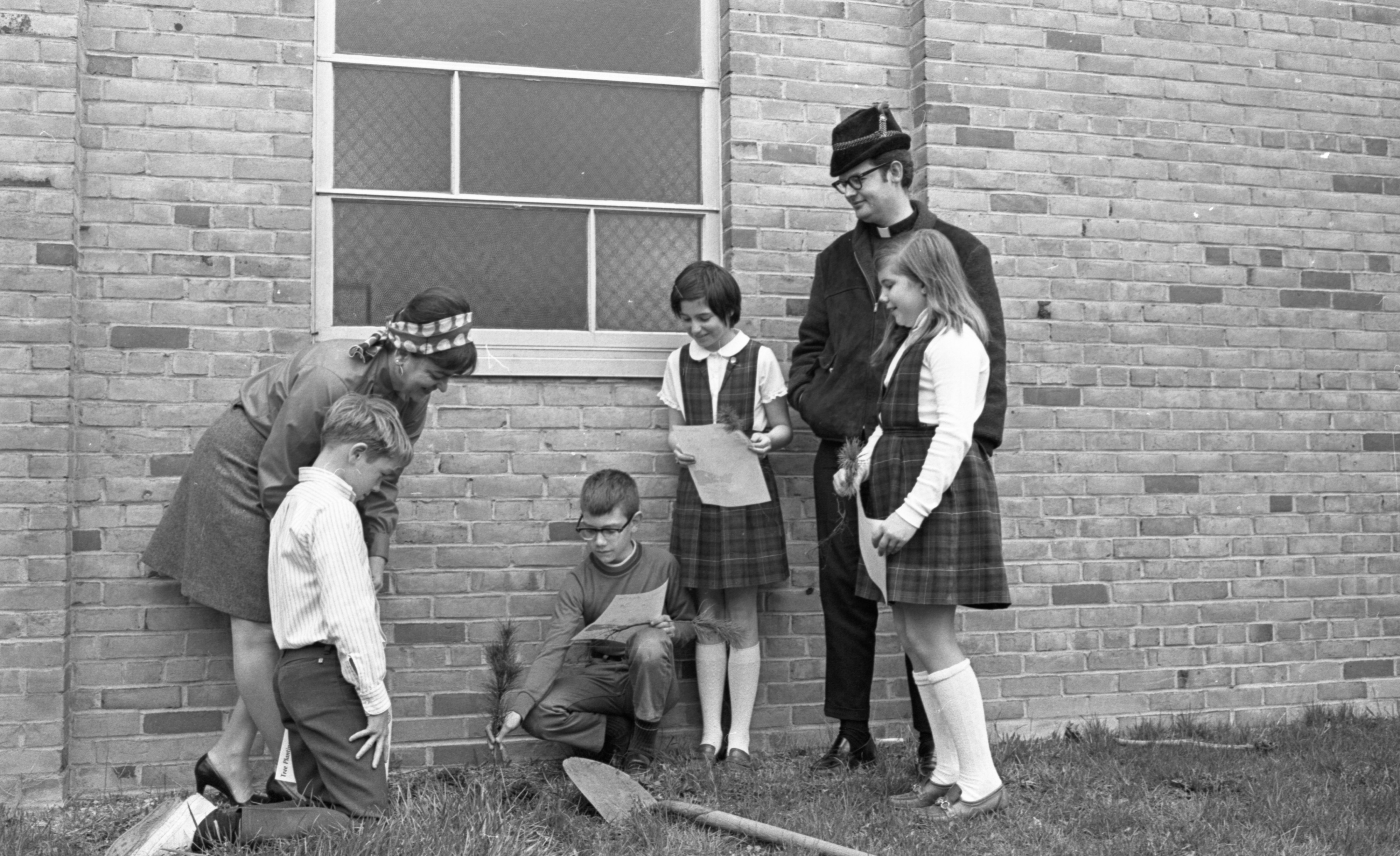 St. Francis Students Plant Trees Outside Their School, April 1970 image