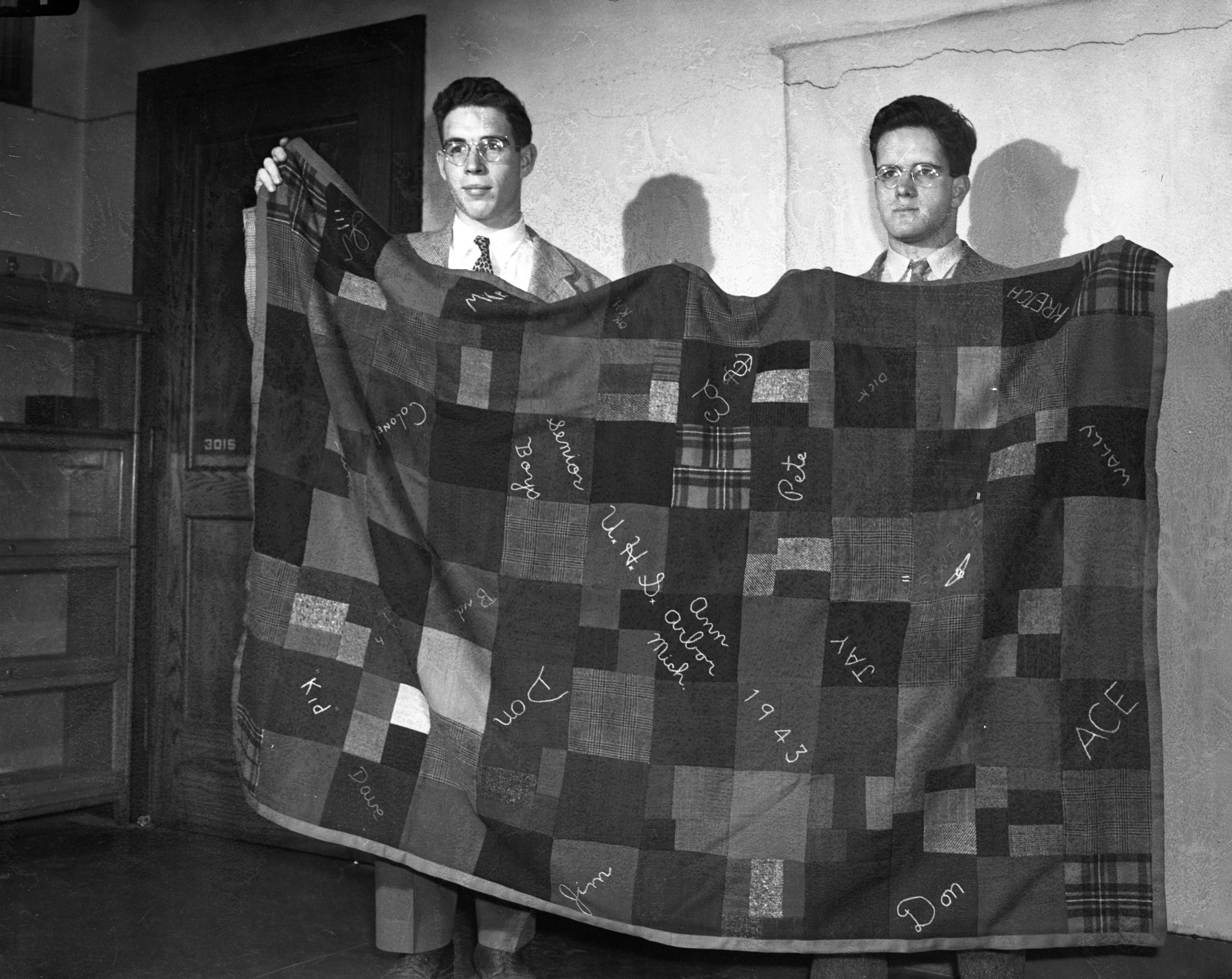 University High School students William Kretzschmar and George Kennard hold a quilt made by 19 UHS boys for the Red Cross, April 1943 image