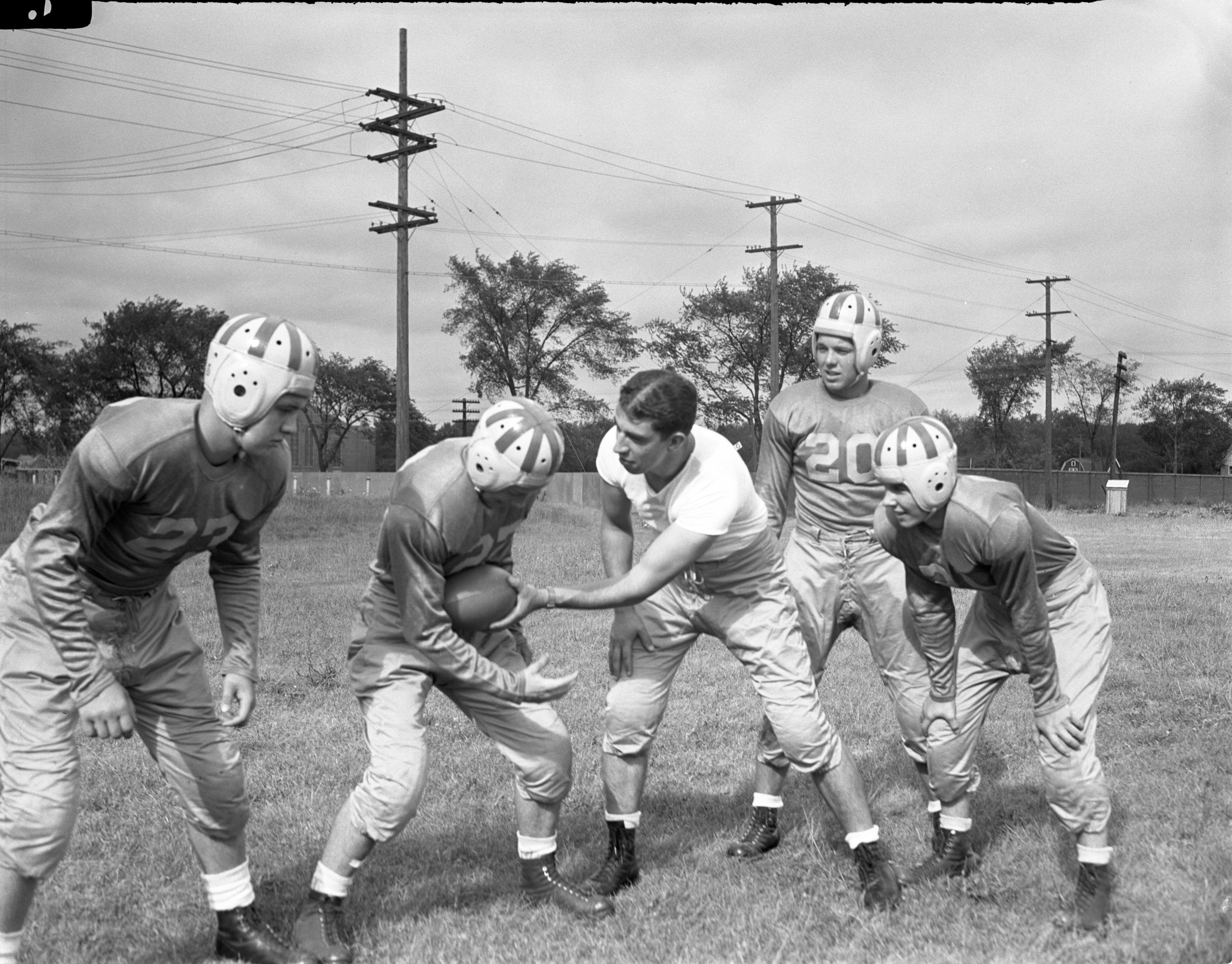 Image from Coach Les Heidamos Explains Ball-Handling At University High School's First Football Practice, August 1945
