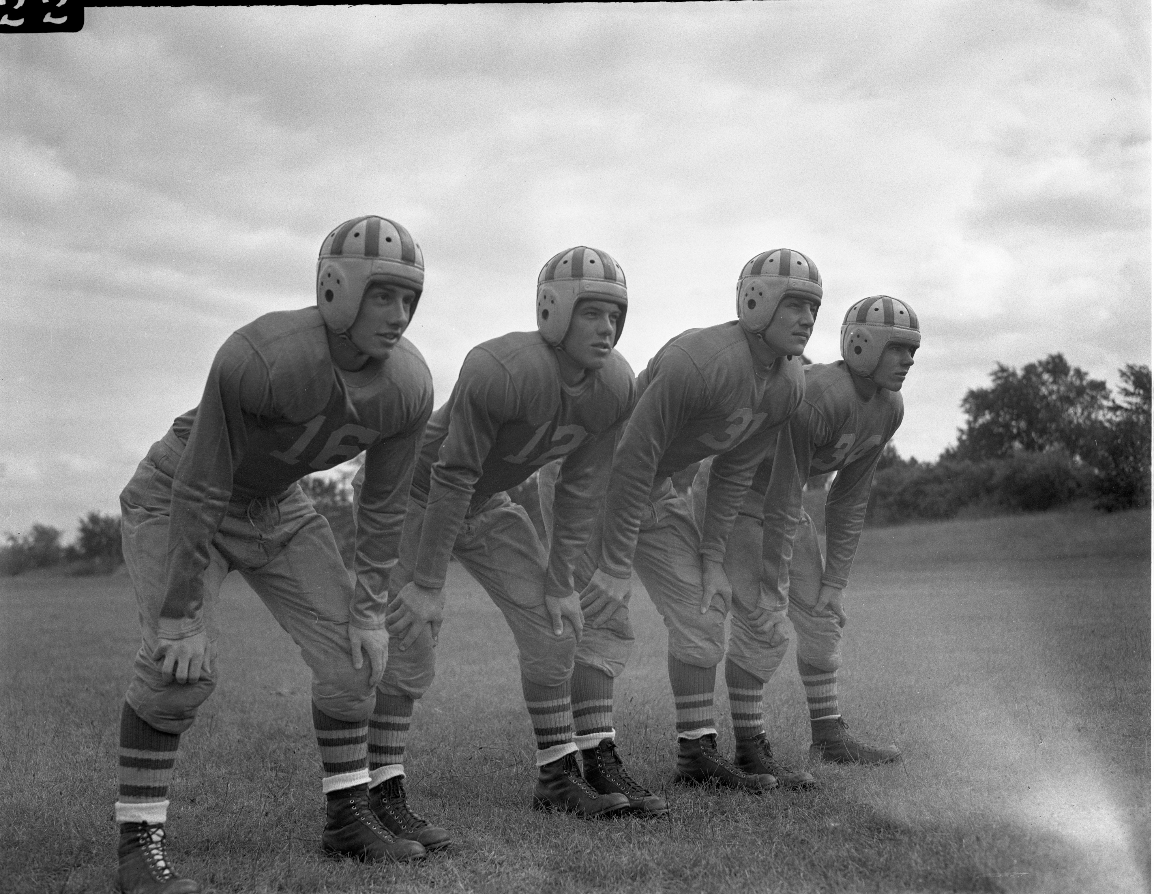 Dude Stephenson, Lee Roy Wasmund, Gary Agnew, & Keith Galpin, University High School Football Team, September 1945 image