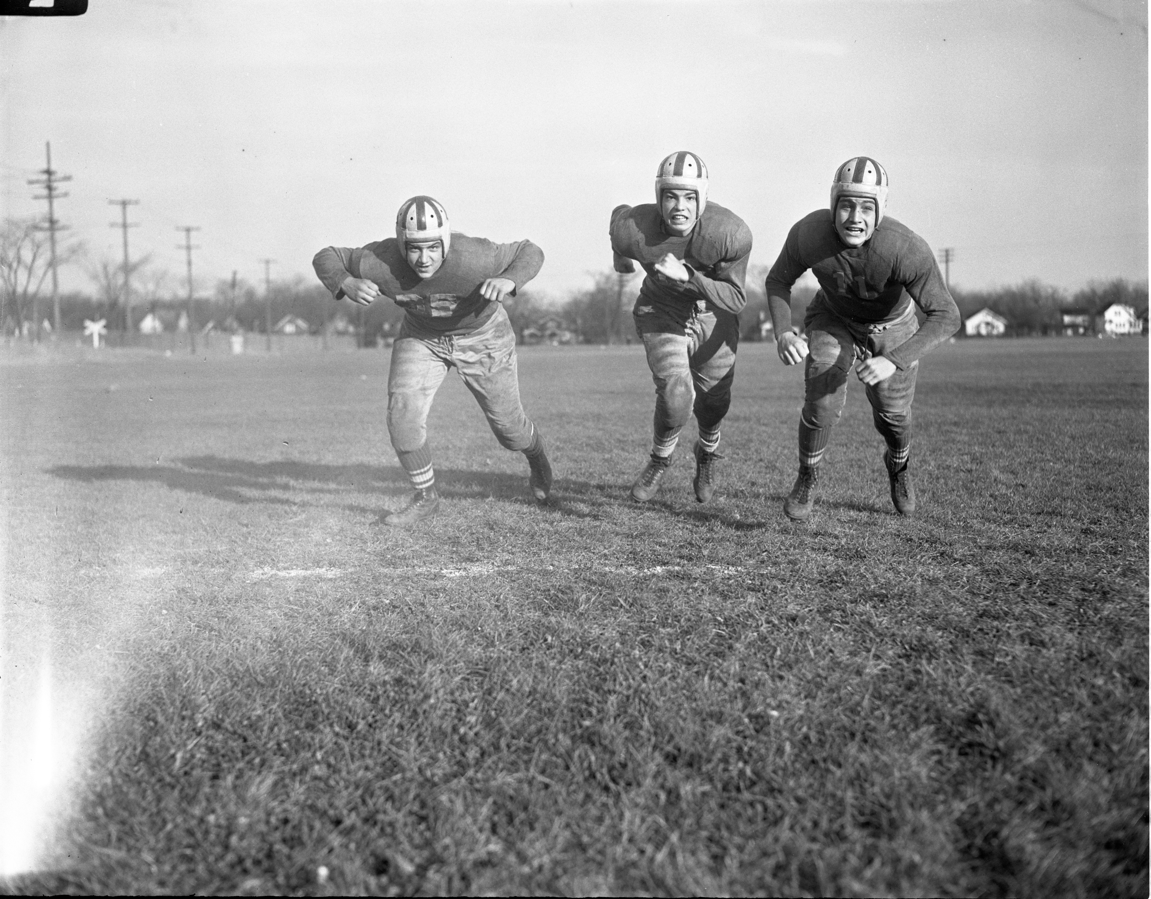 Jack Spencer, Jim Gentry, & Gary Agnew, University High School Football Team, November 1945 image