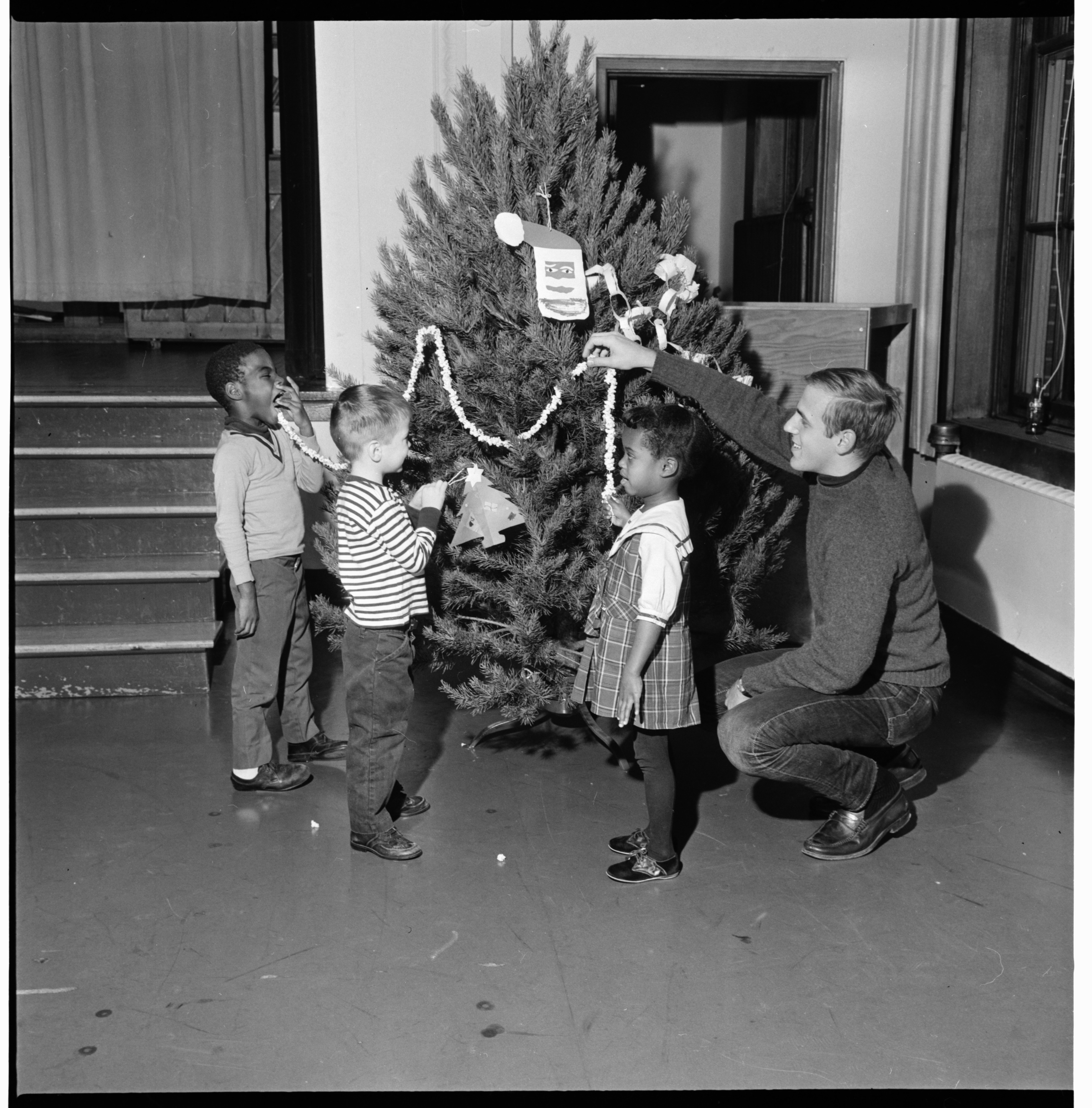 Headstart Participants Decorate Christmas Tree at Jones School, December 1966 image