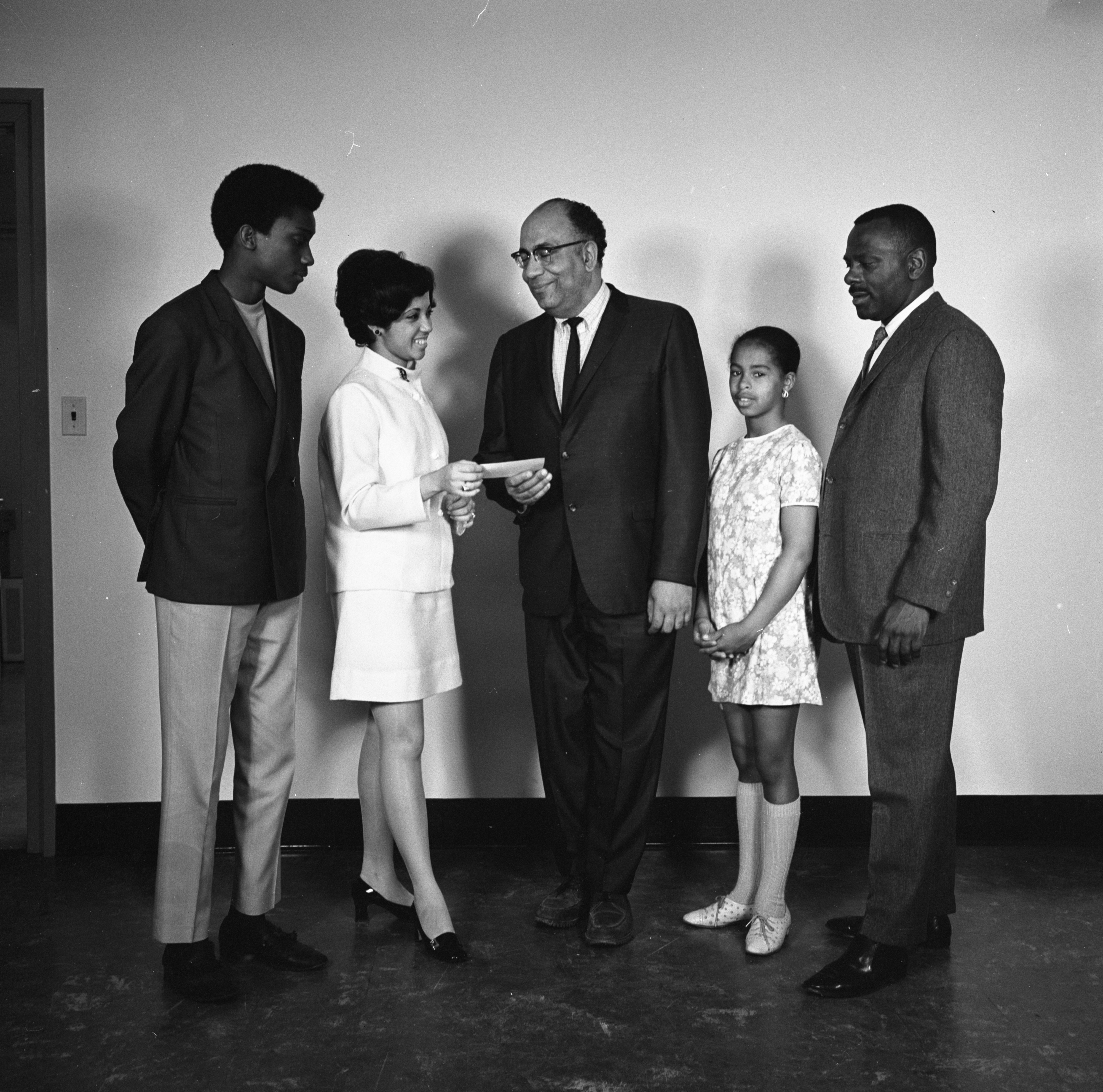 "Miss Ann Arbor Presents Fund Drive Check To ""Our Own Thing"" Organization, April 1969 image"