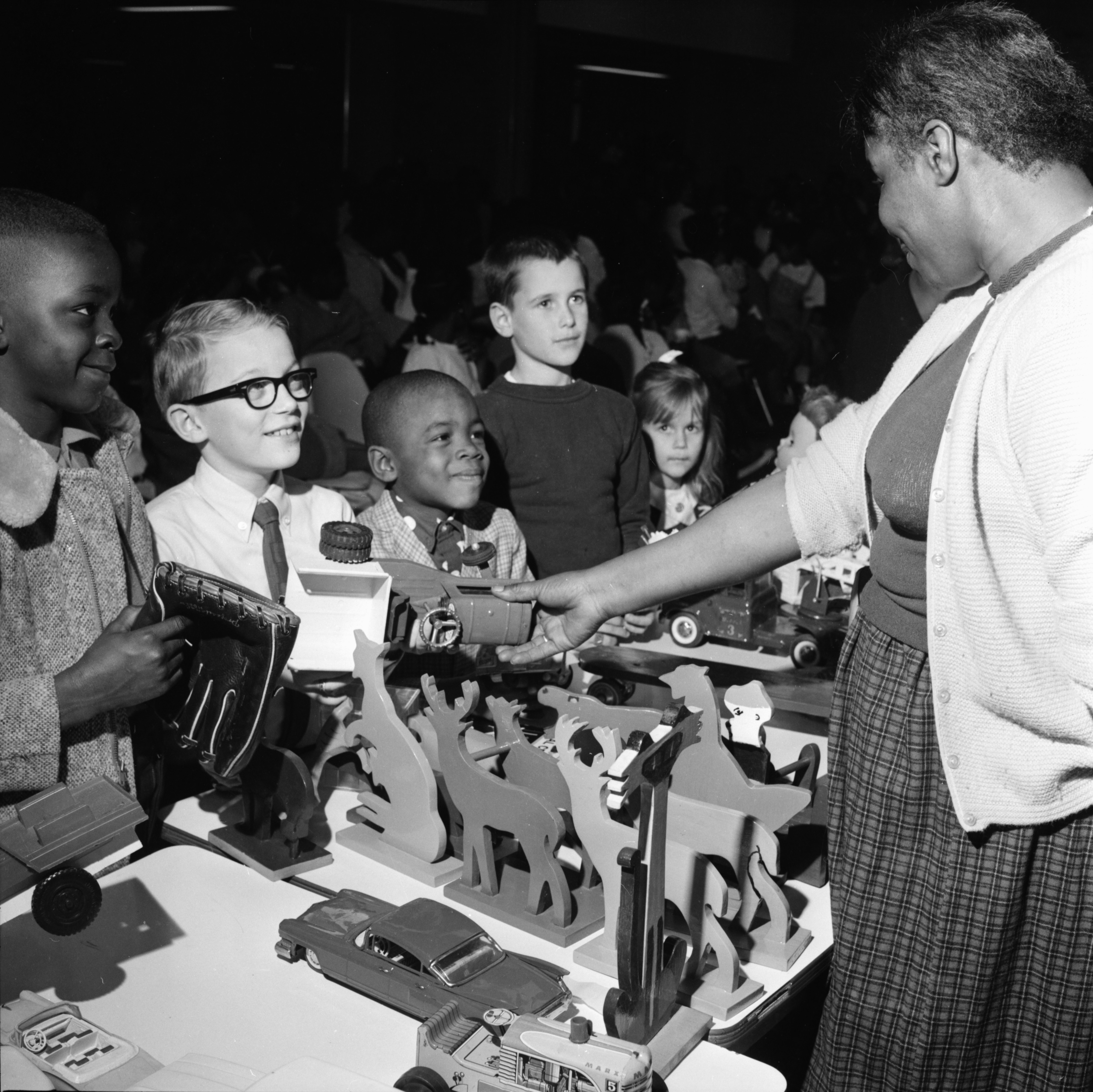 Children Receive Gifts from Marie Douglas at the Ann Arbor Community Center Christmas Party, December 1966 image