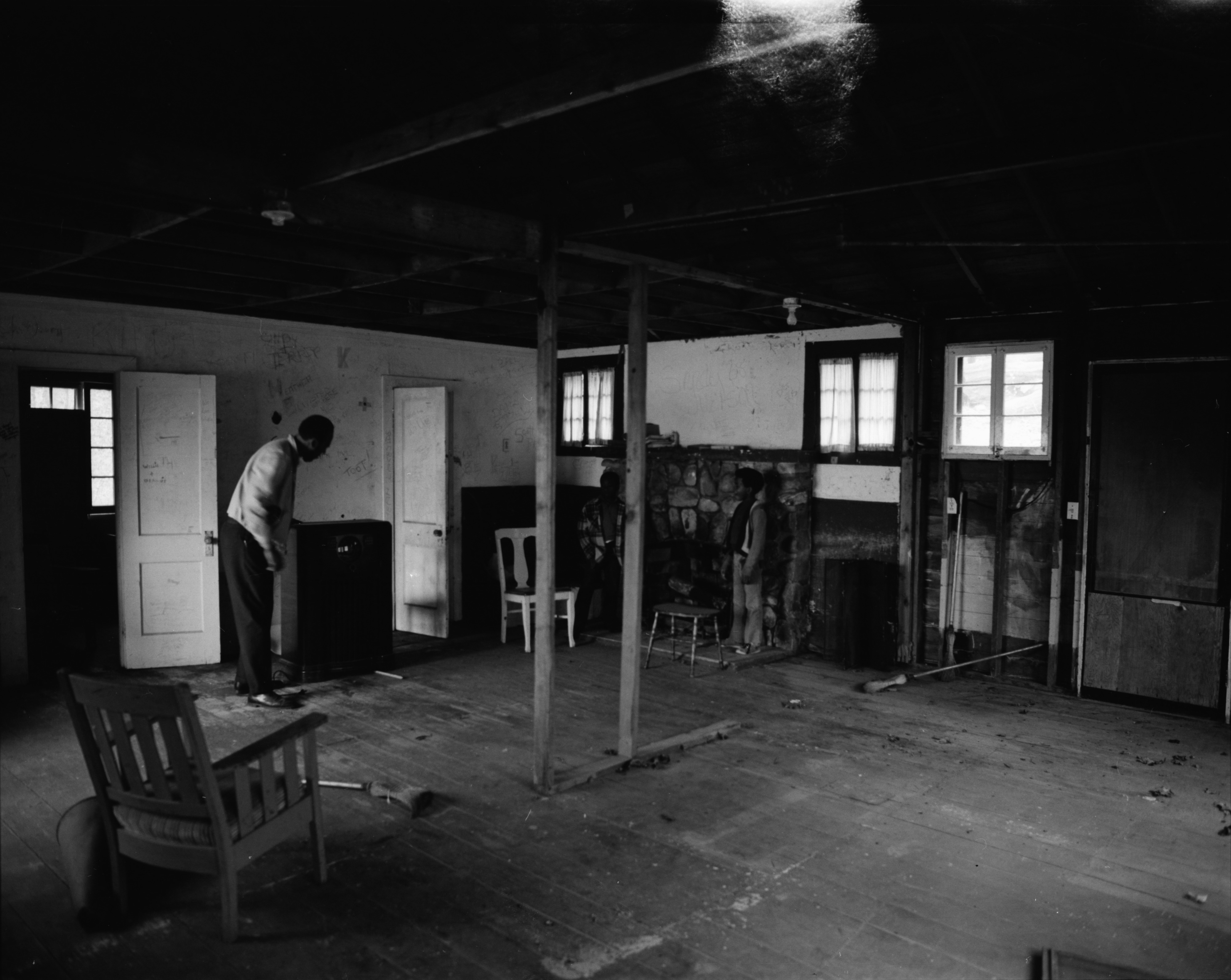 Director Walter Hill Examines Interior of Main Hall at the Ann Arbor Community Center's Camp Takona, June 1972 image