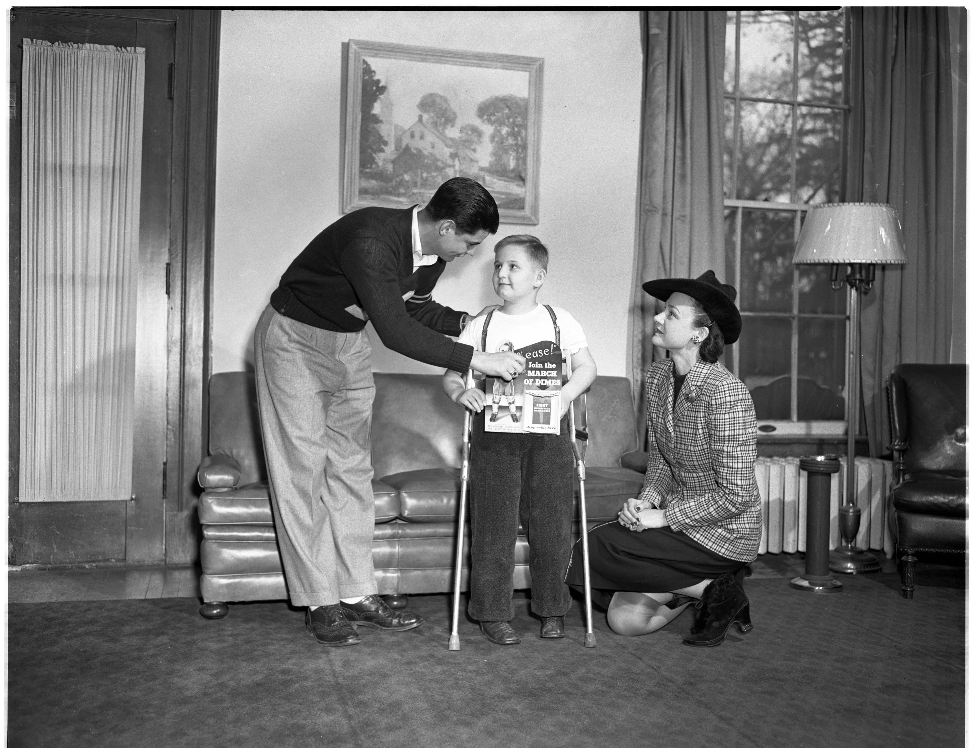 University of Michigan All-American and Rose Bowl Star Bob Chappuis Contributes To March of Dimes Campaign, January 1948 image