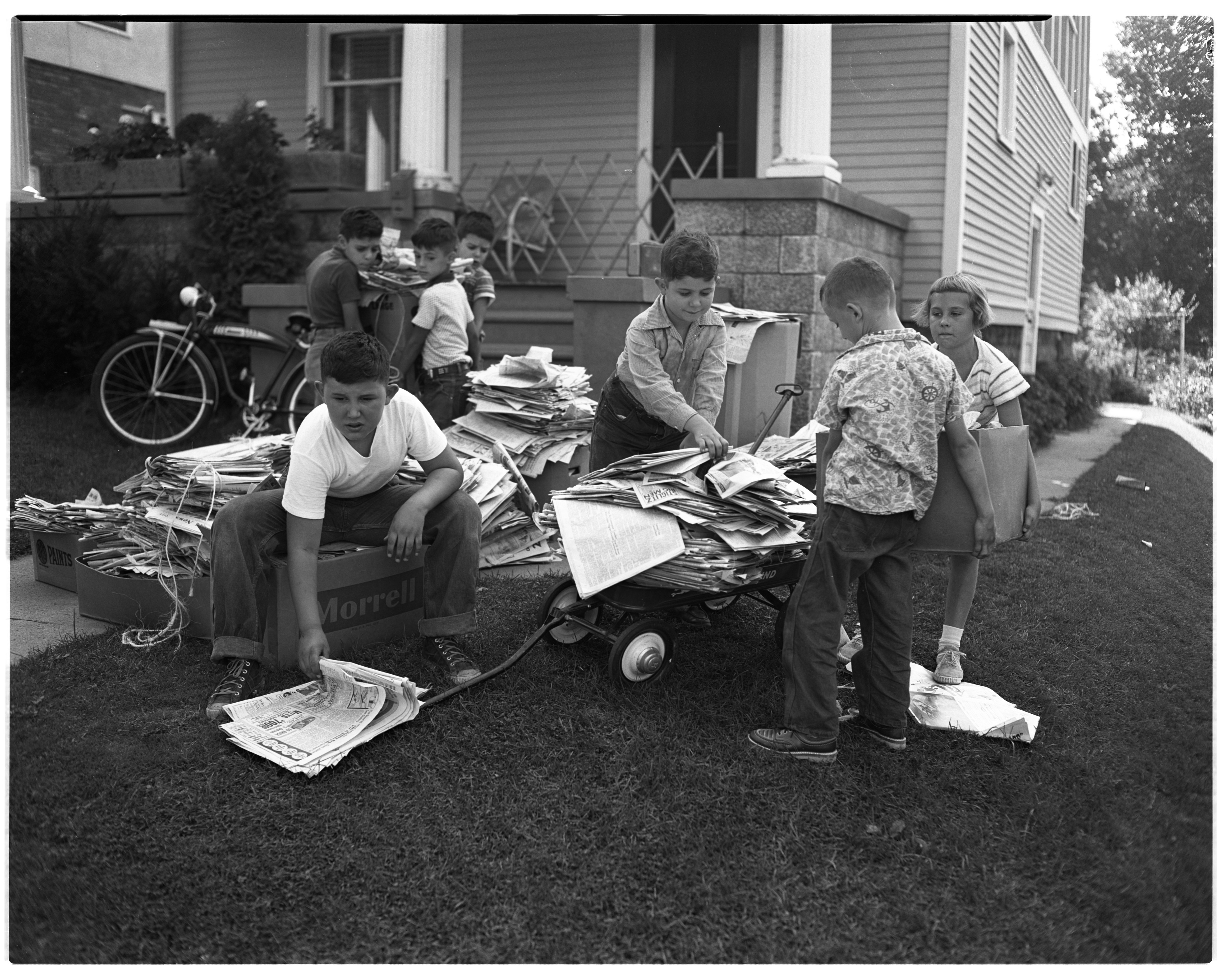 Boys collect papers for polio drive on S. Seventh St., August 1954 image