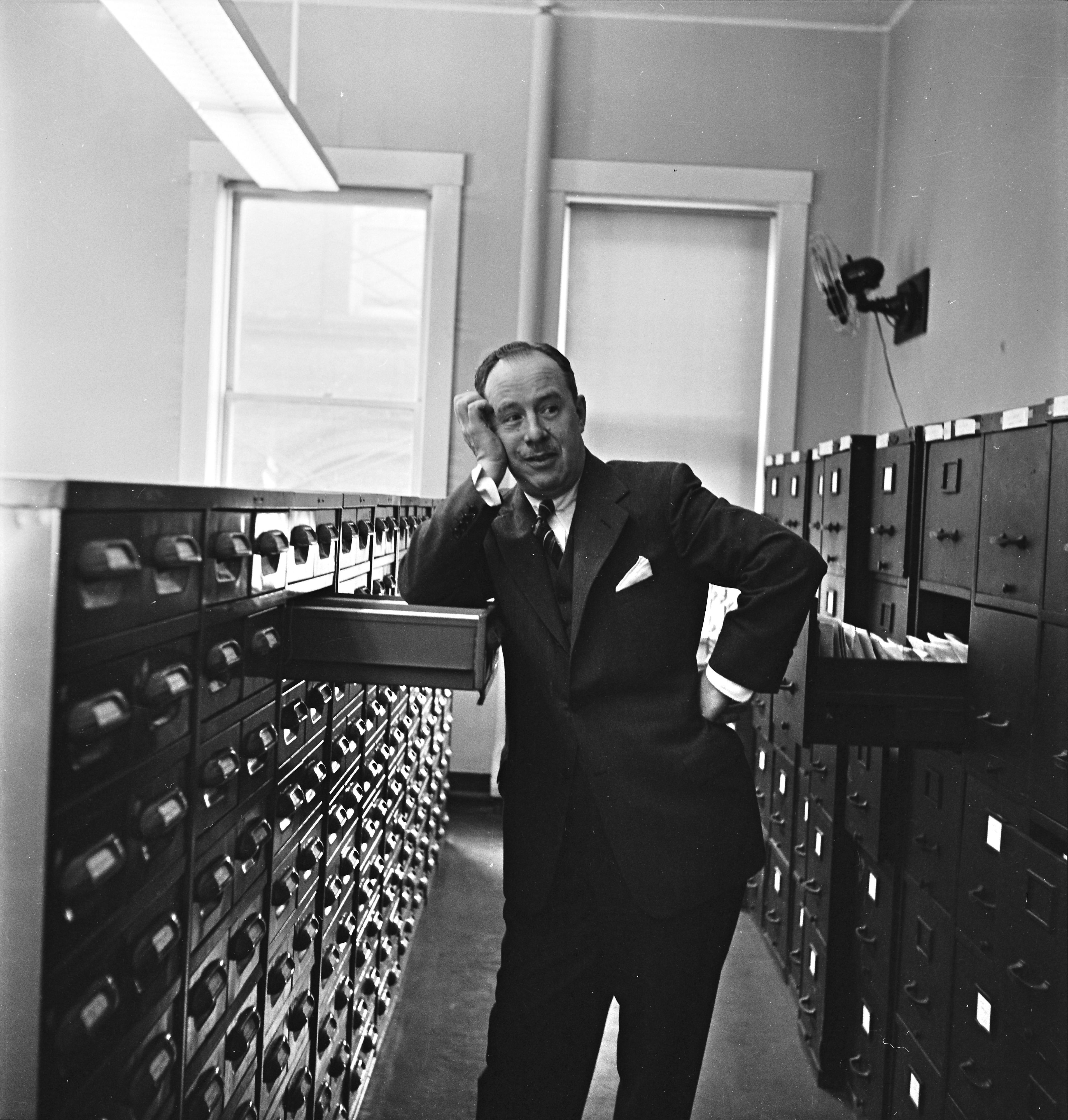 Dr. Thomas Francis, with file drawers containing statistical medical information, April 1955 image