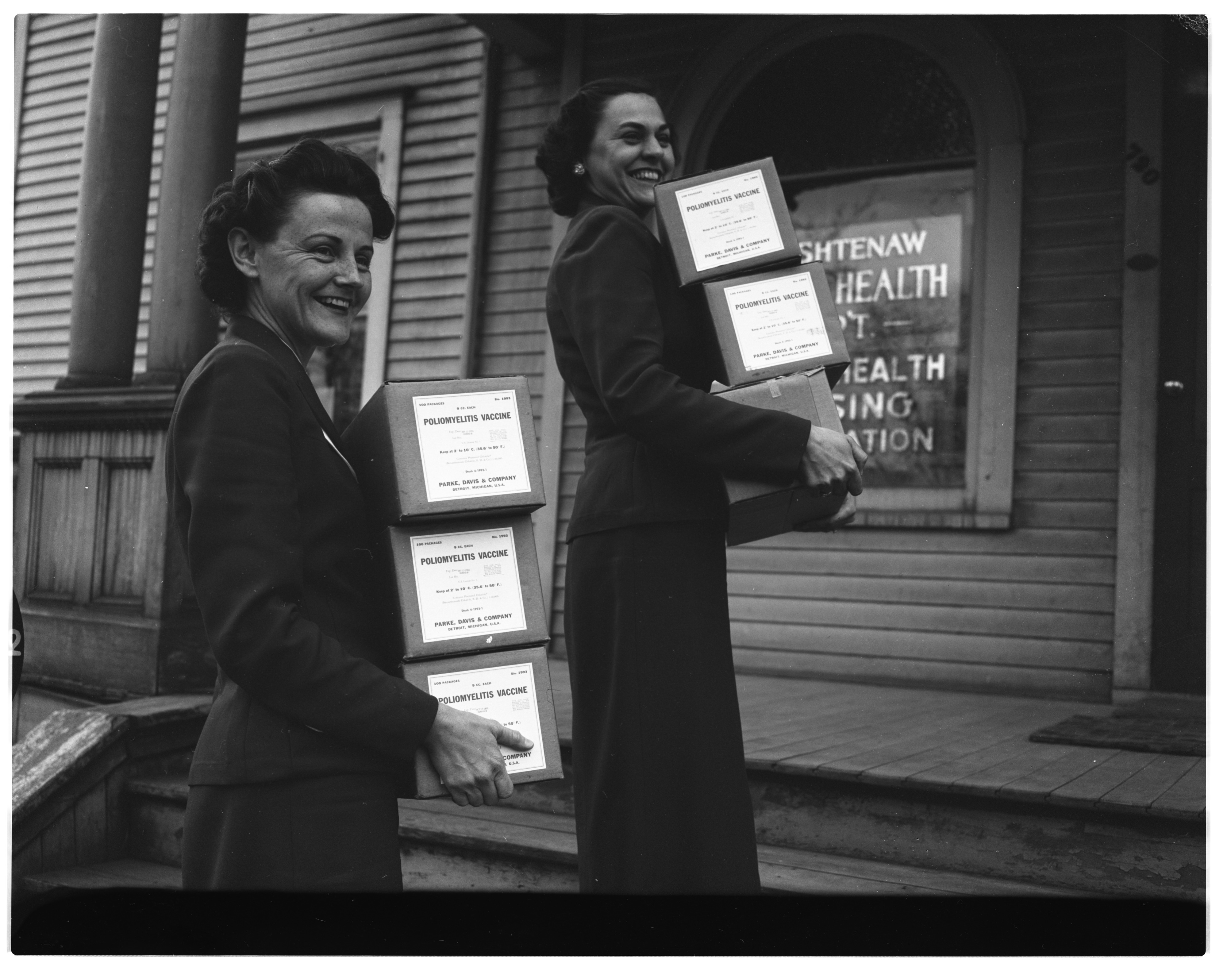 Kay Dohm and and Mrs. James A. Nichols with first shipment of Salk polio vaccine for Washtenaw county first and second graders, April 1955 image