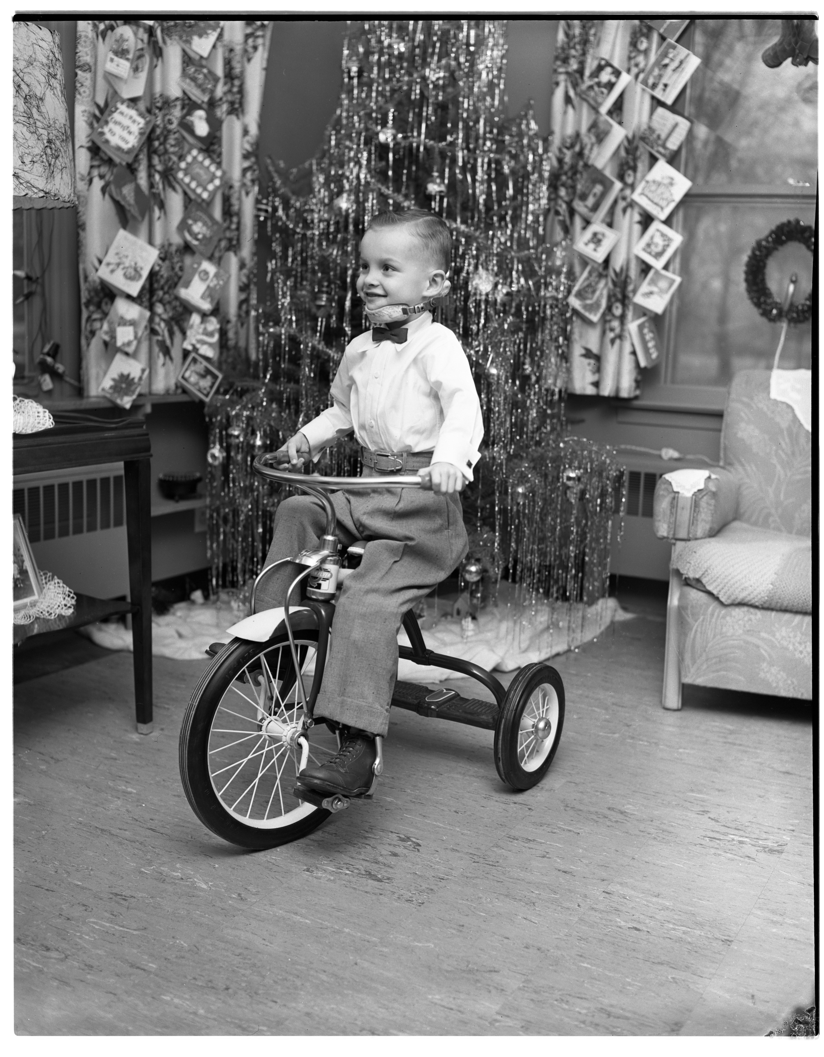 David Bauer rides his new tricycle, December 1955 image