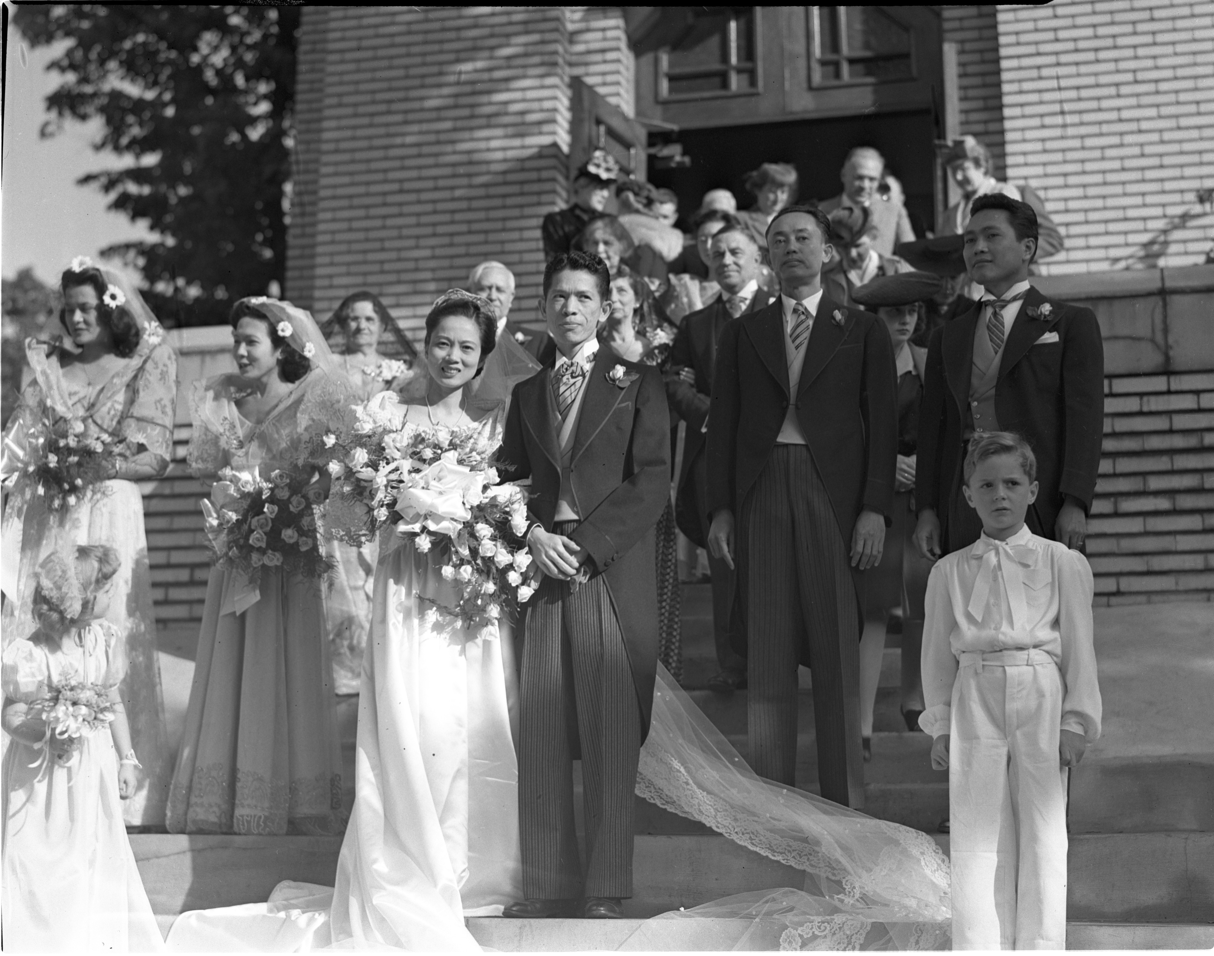 Newly Married Rafaelita Hilario & Dr. Jesus L. Soriano Leave St. Mary's Chapel - September 25, 1943 image