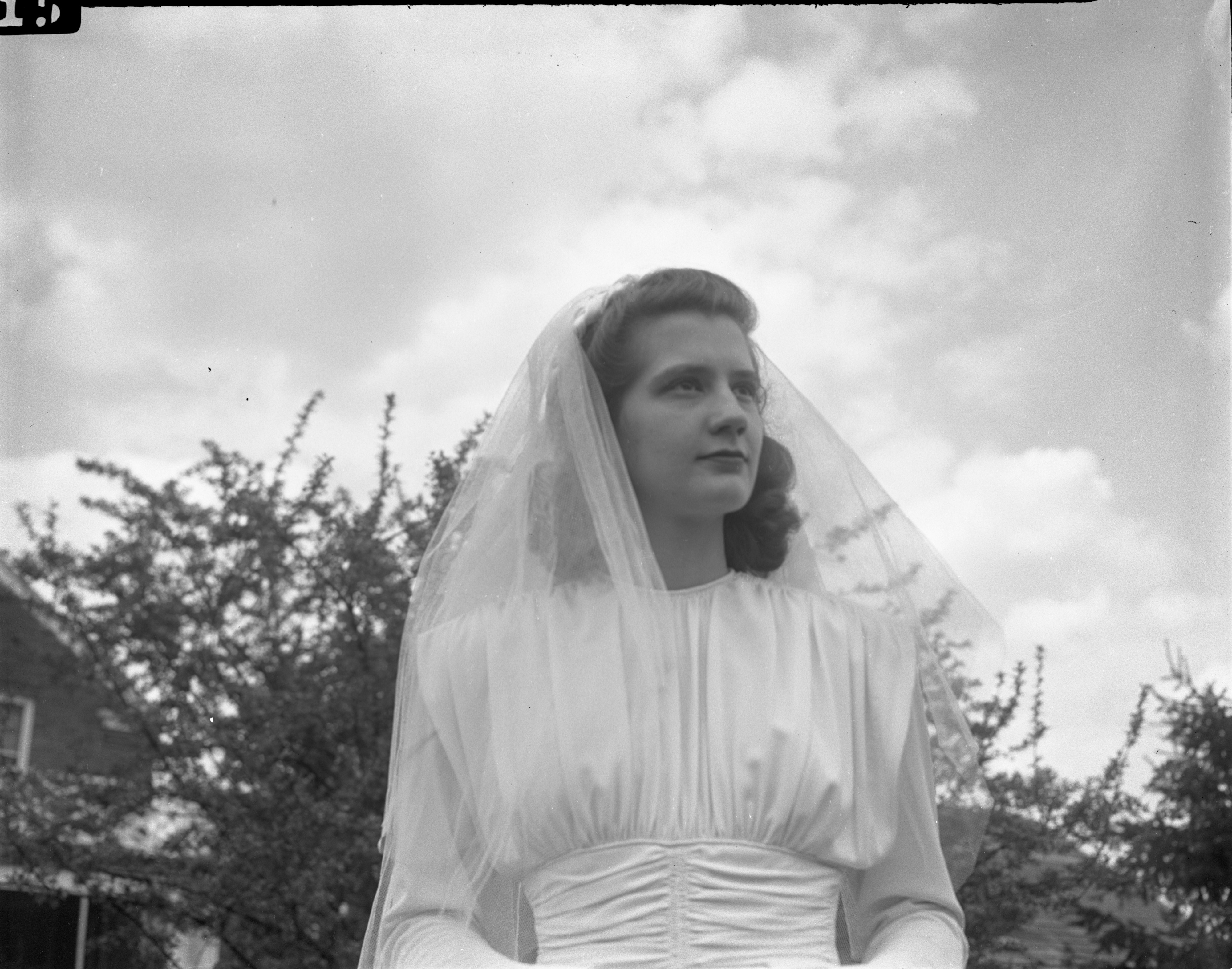 Eleanor Barker, Fiancée Of Ernest Hardin, Models The Wedding Gown She Will Wear At Their Overseas Wedding, April 1946 image