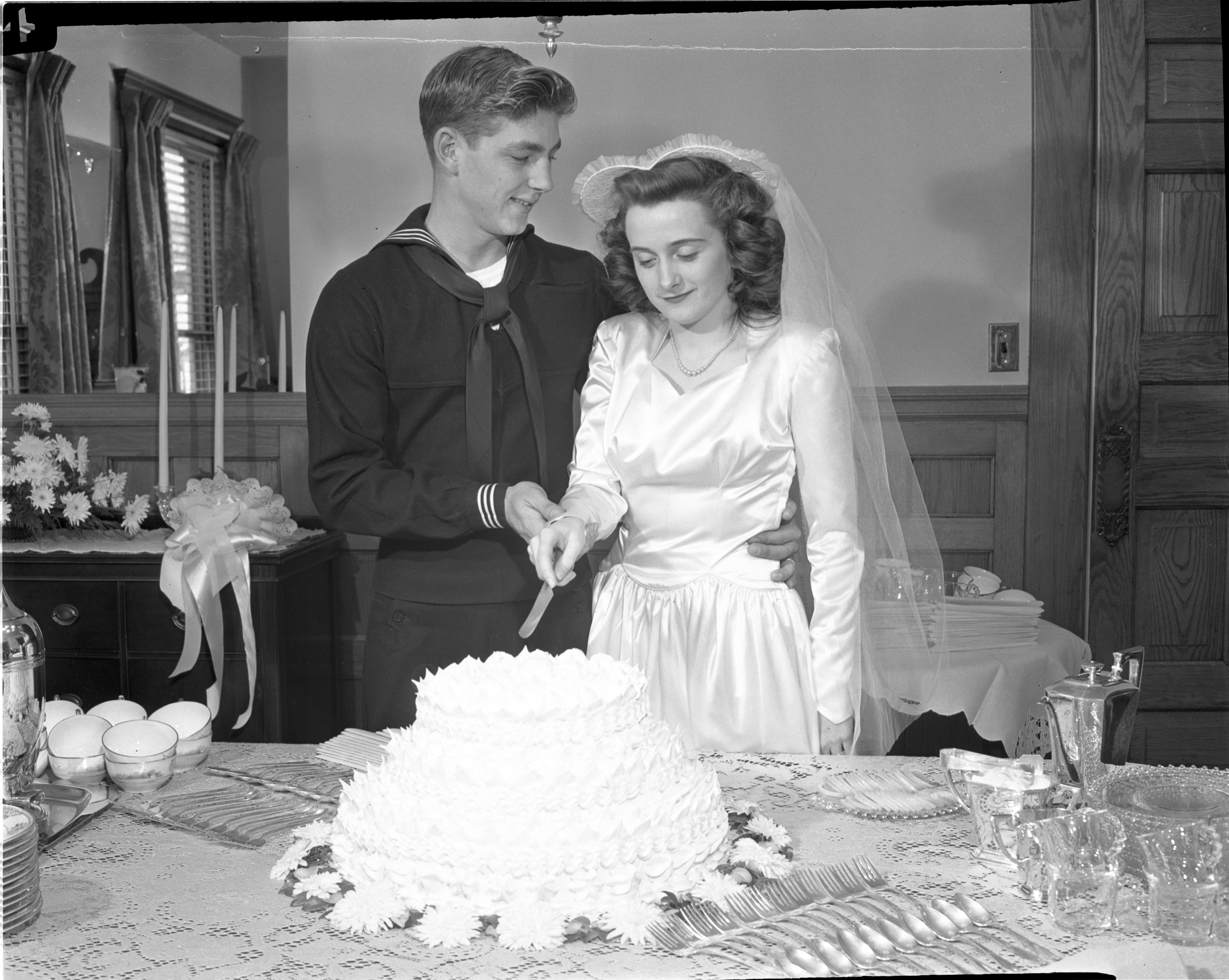 Walter & Patricia Bartell Cut Their Wedding Cake - December 15, 1945 image