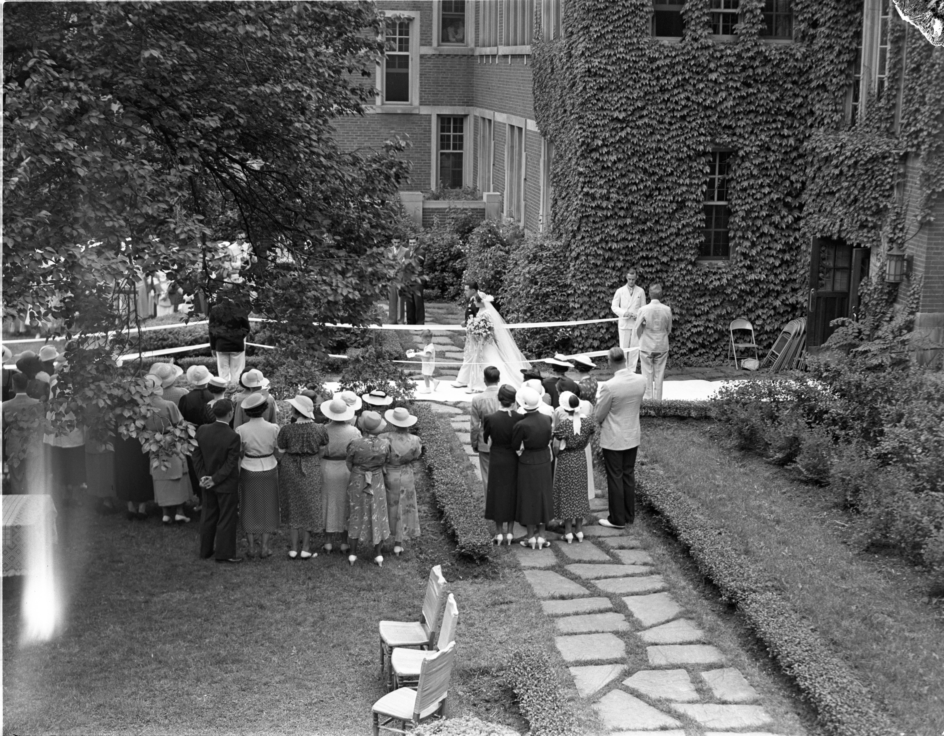 Ring Bearer, Donald Prochnow, Leads Virginia DeLong Down The Aisle At Her Michigan League Garden Wedding - June 16, 1937 image