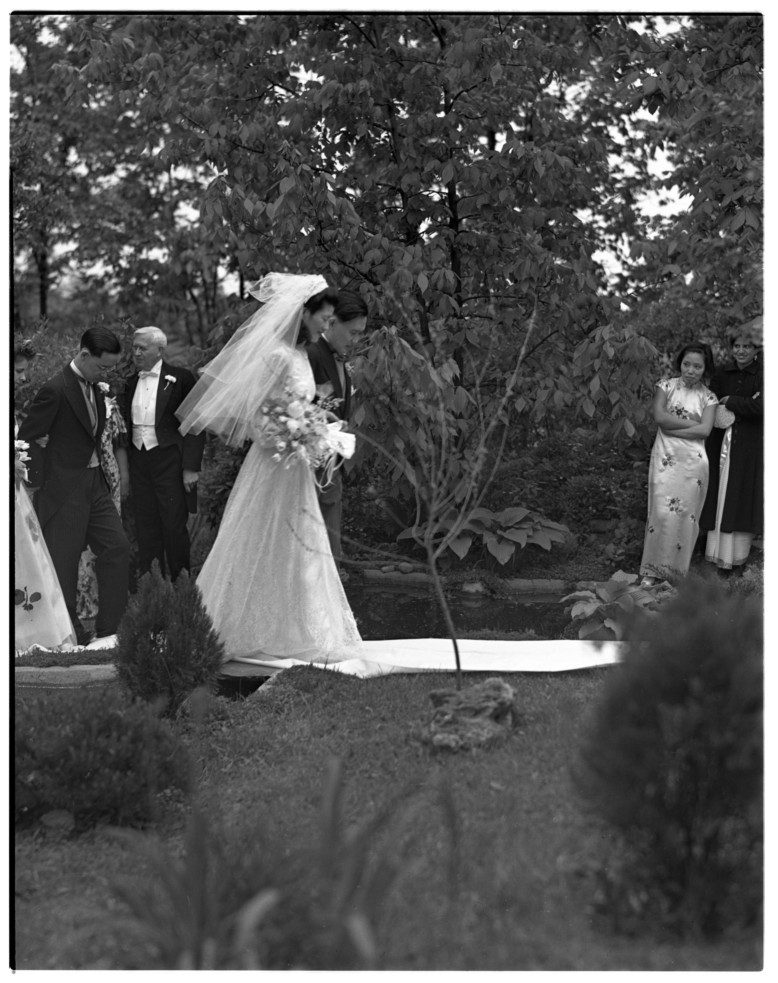 Newlyweds Choon Cha Lee and Carl Kwak Walk on Garden Path, May 1942 image