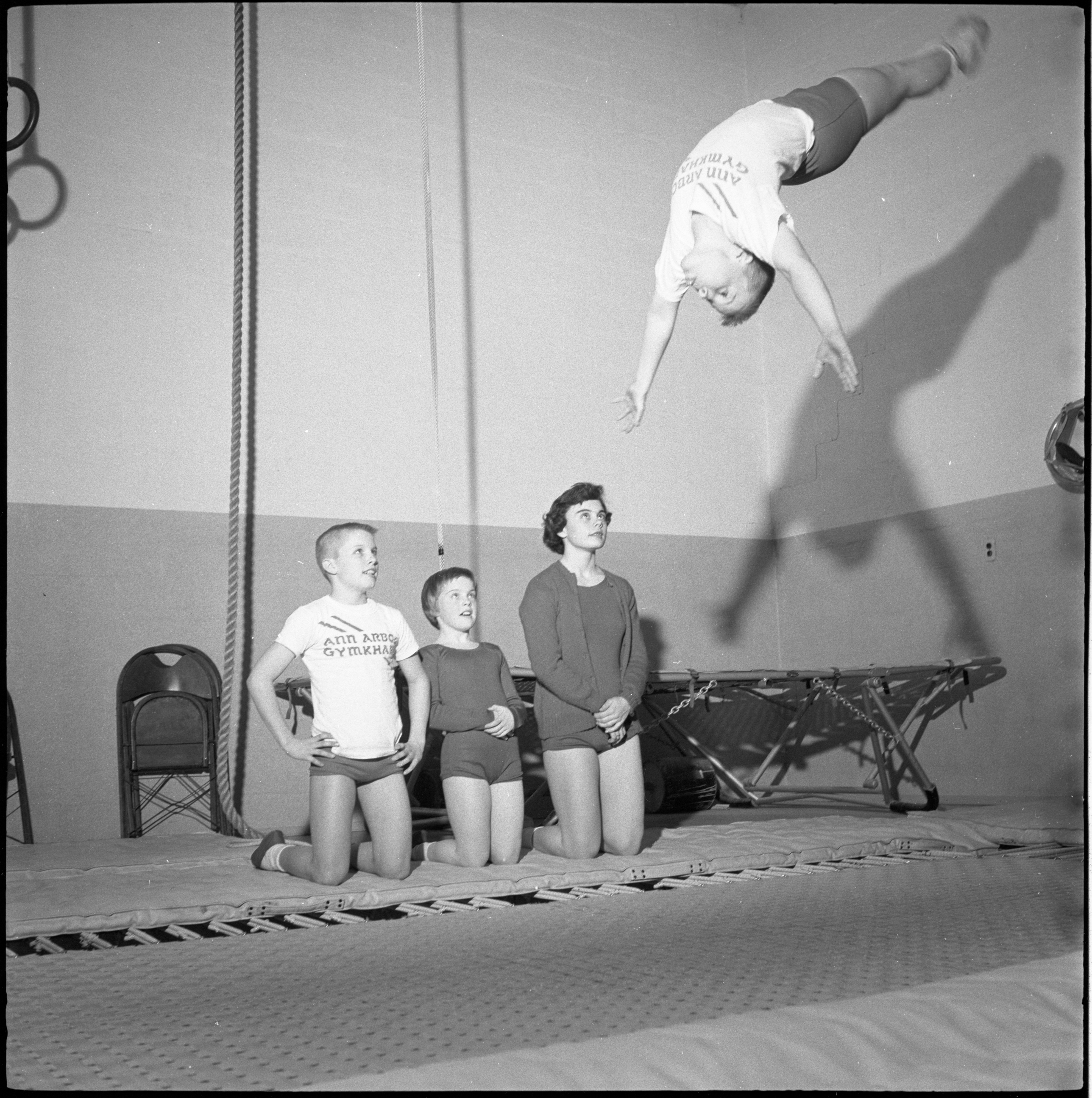 Tom Huntzicker Practices His Competitive Trampoline Routine At The Ann Arbor Gymkhana, April 1960 image