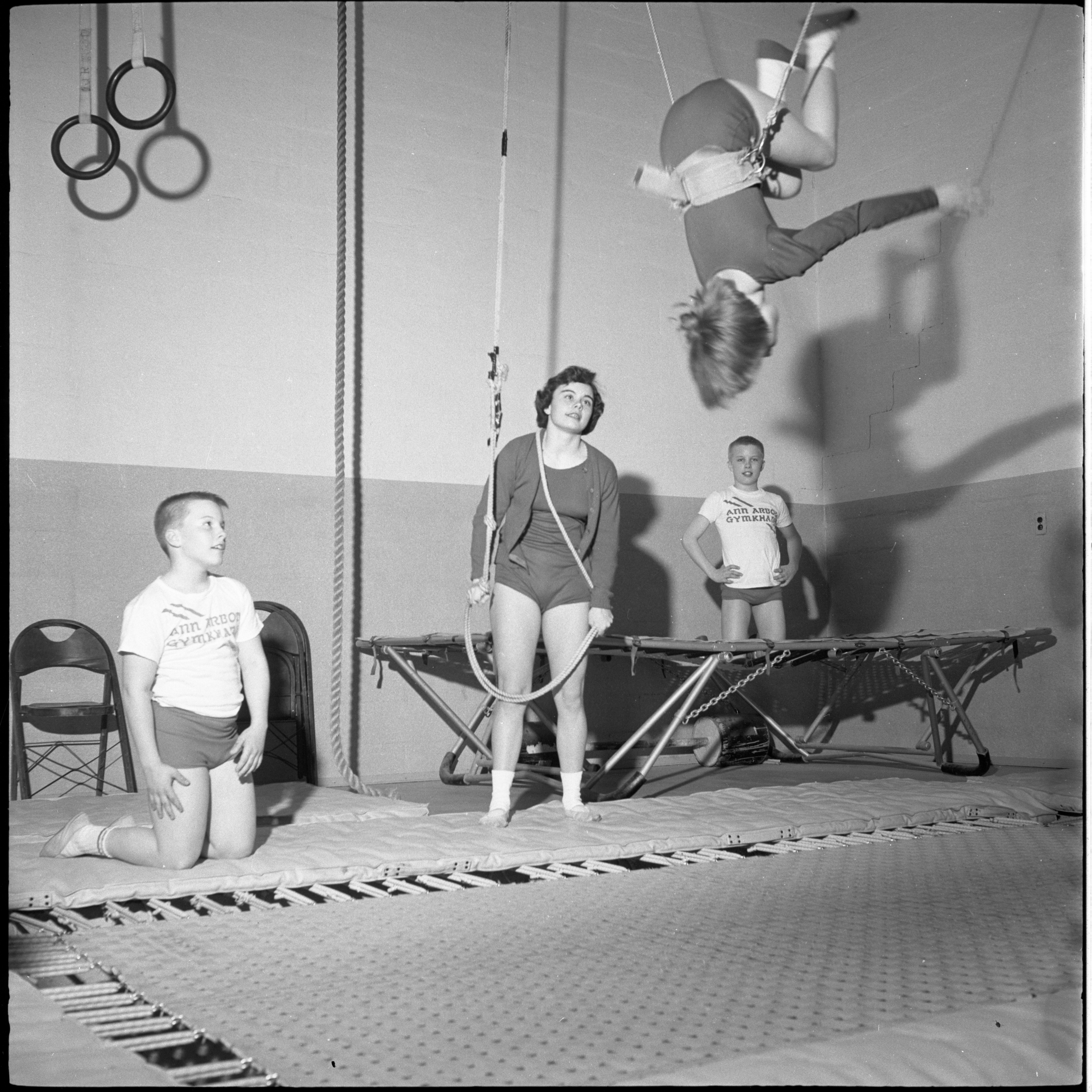 Susie Huntzicker Practices Her Competitive Trampoline Routine At The Ann Arbor Gymkhana, April 1960 image