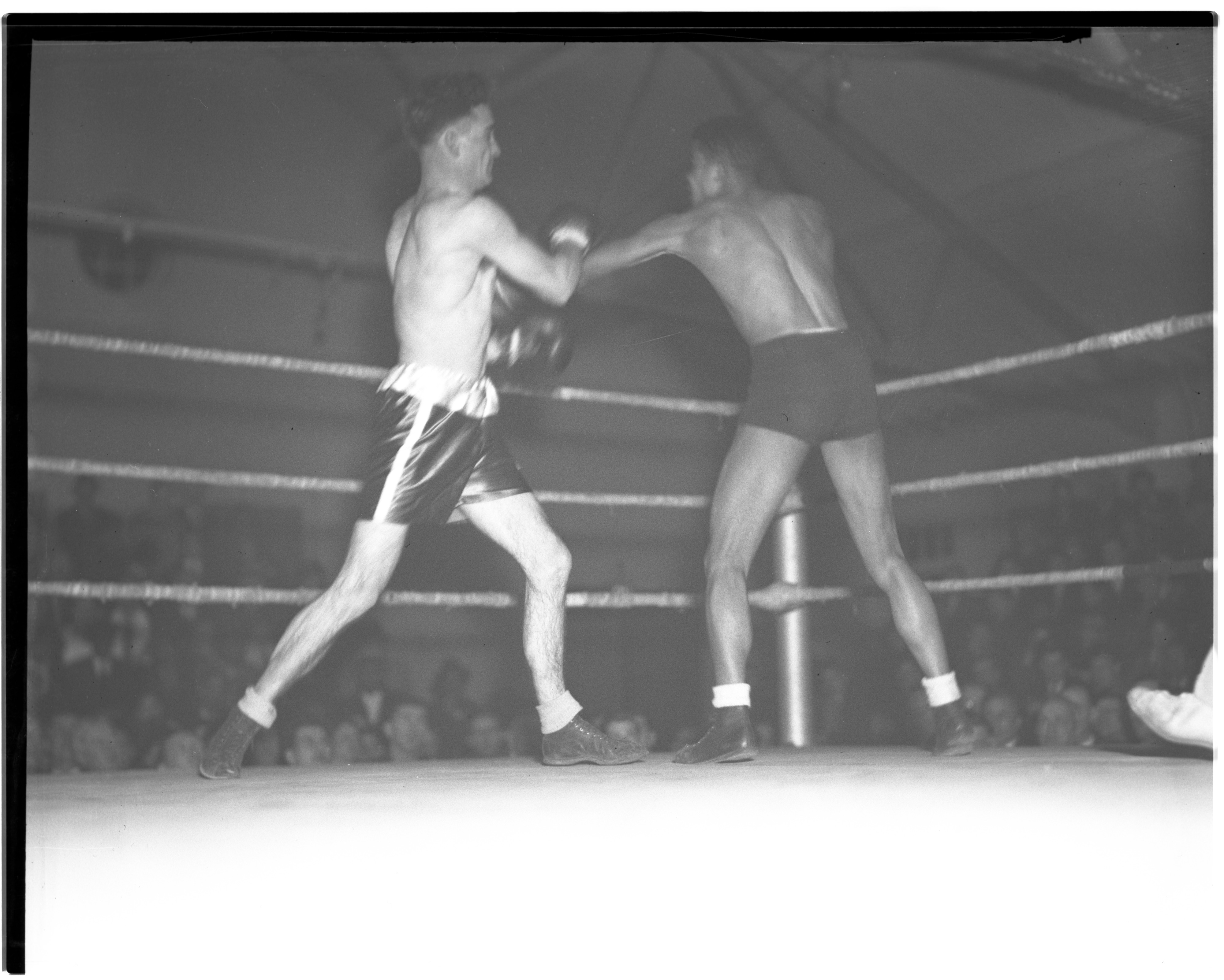 Gerald Coon and Eddie Scott during a Golden Gloves bout, January 1936  image