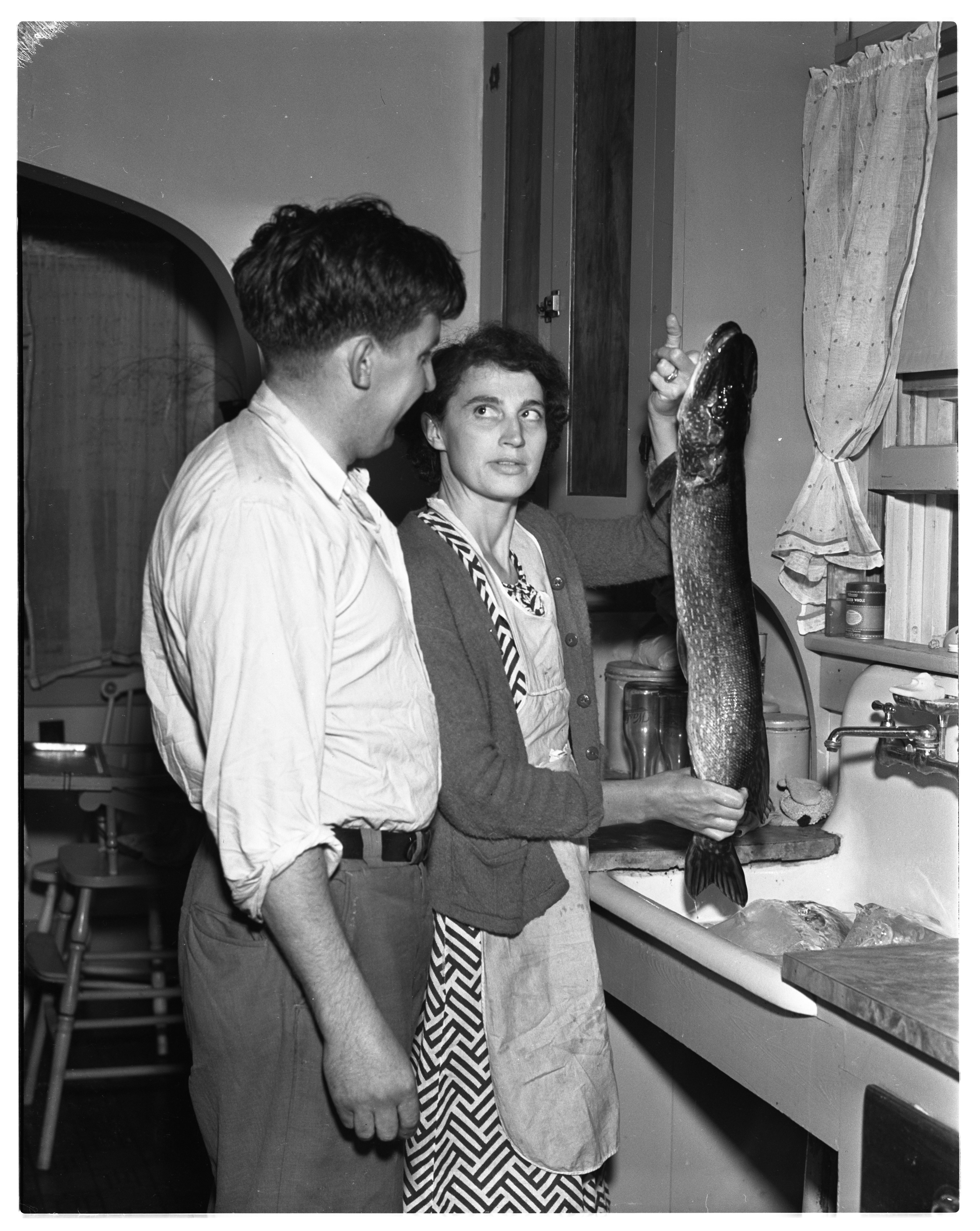 Mr. and Mrs. Howard Haines of 7th St. With Big Pike, June 1937 image