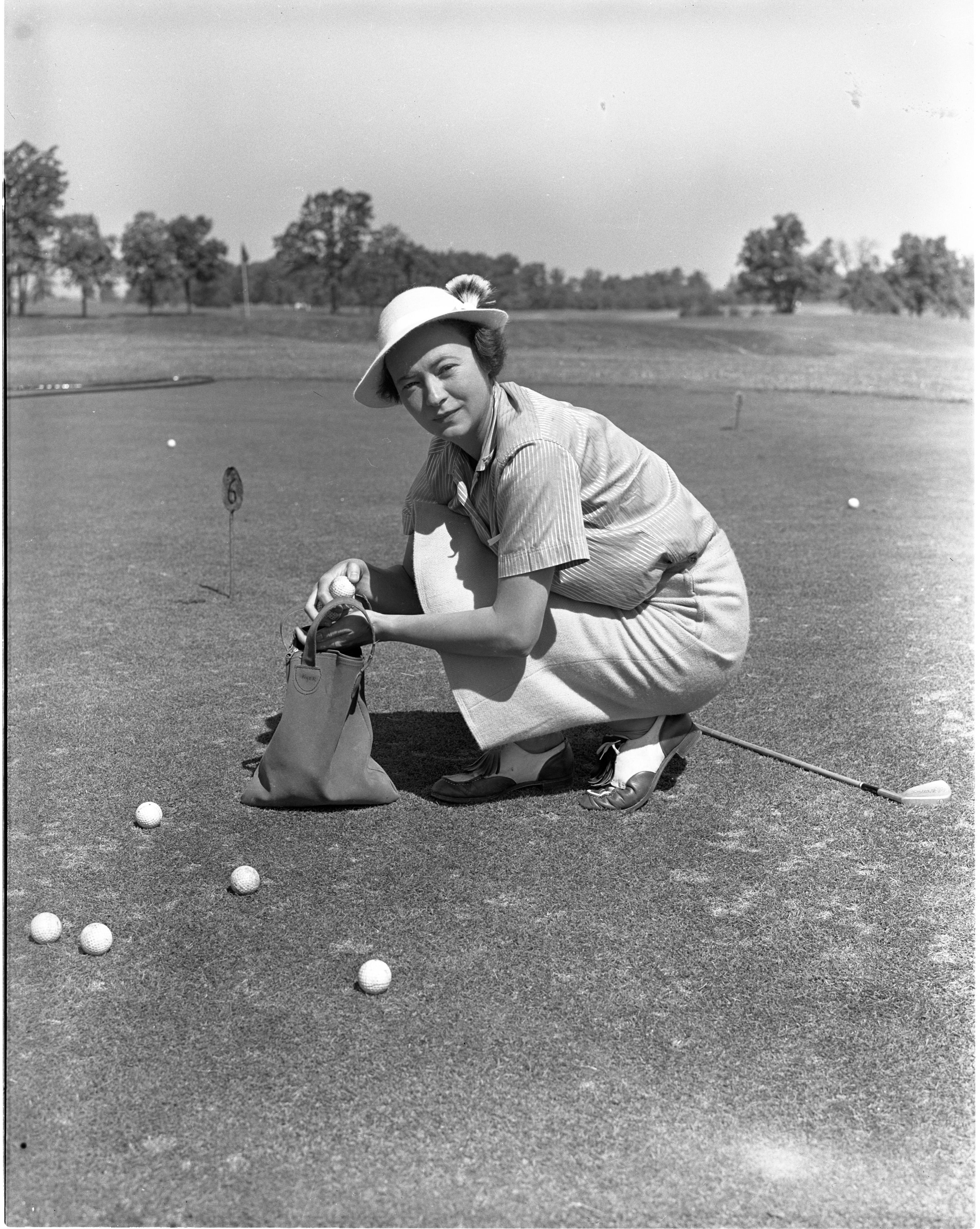 Jean Kyer Picks Up Practice Golf Balls At Barton Hills, May 1939 image