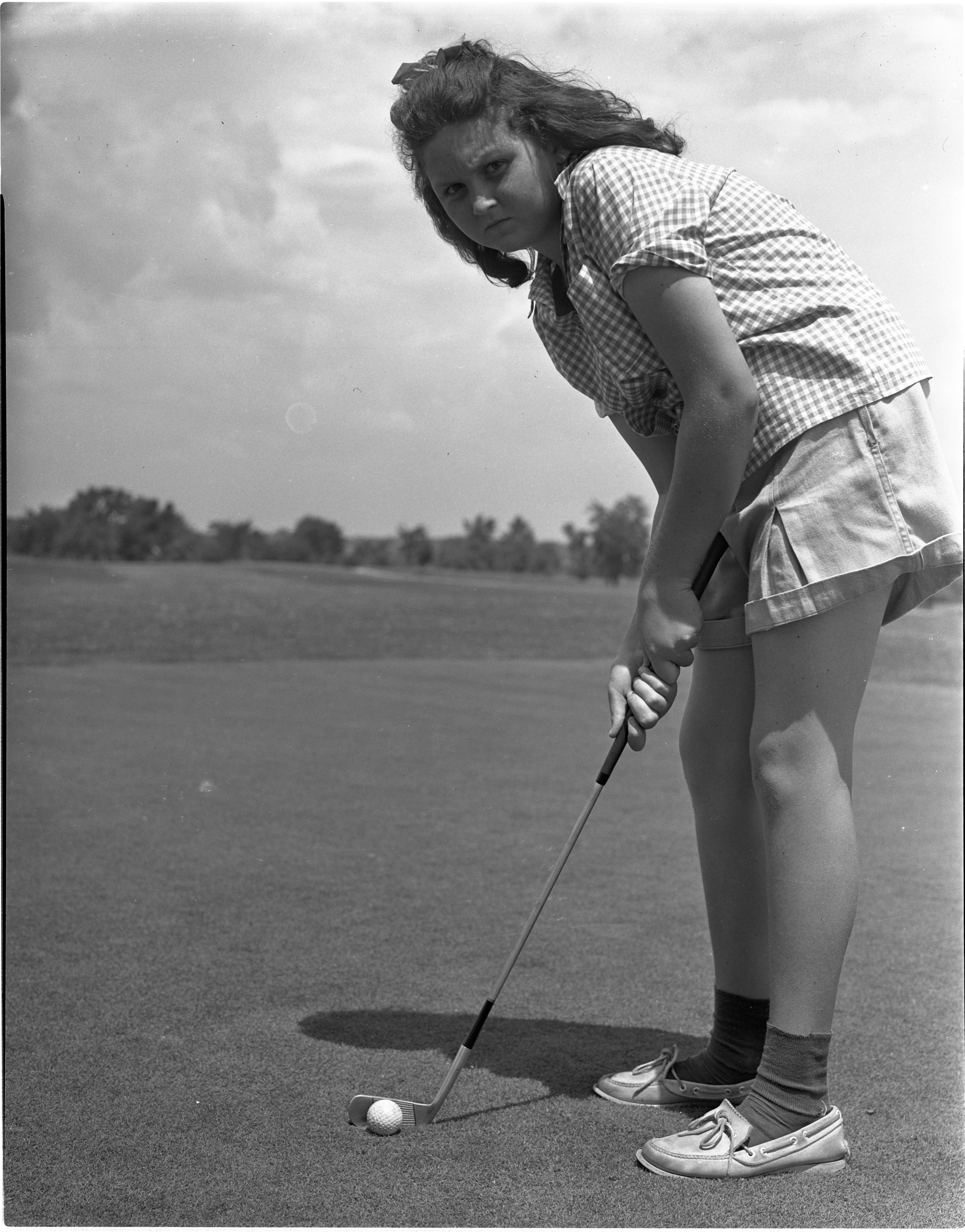 Angela Dobson Eyes Her Target In The Women's City Golf Tournament Qualifying Rounds At Barton Hills, July 1939 image