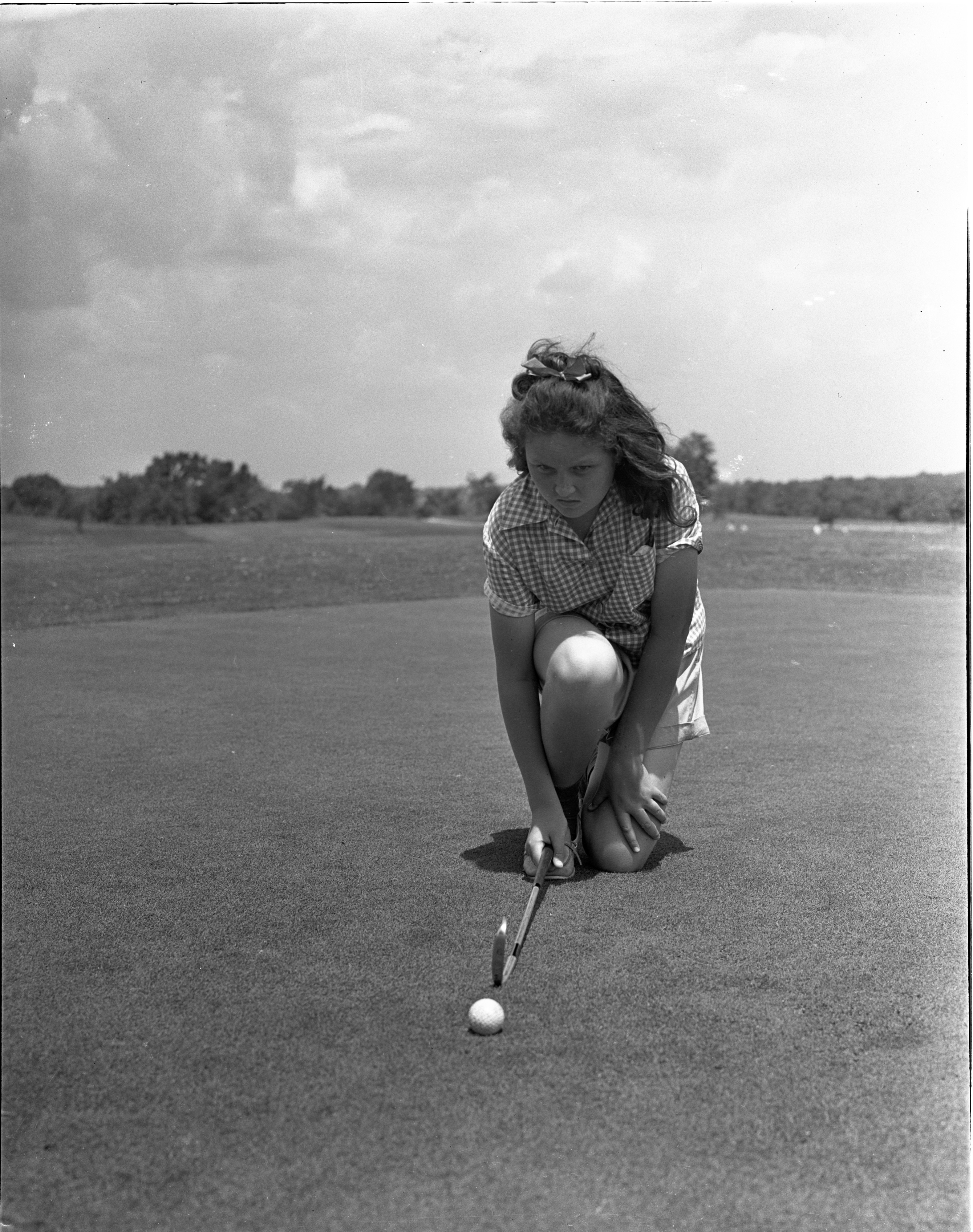Angela Dobson Lines Up A Putt In The Women's City Golf Tournament Qualifying Rounds At Barton Hills, July 1939 image