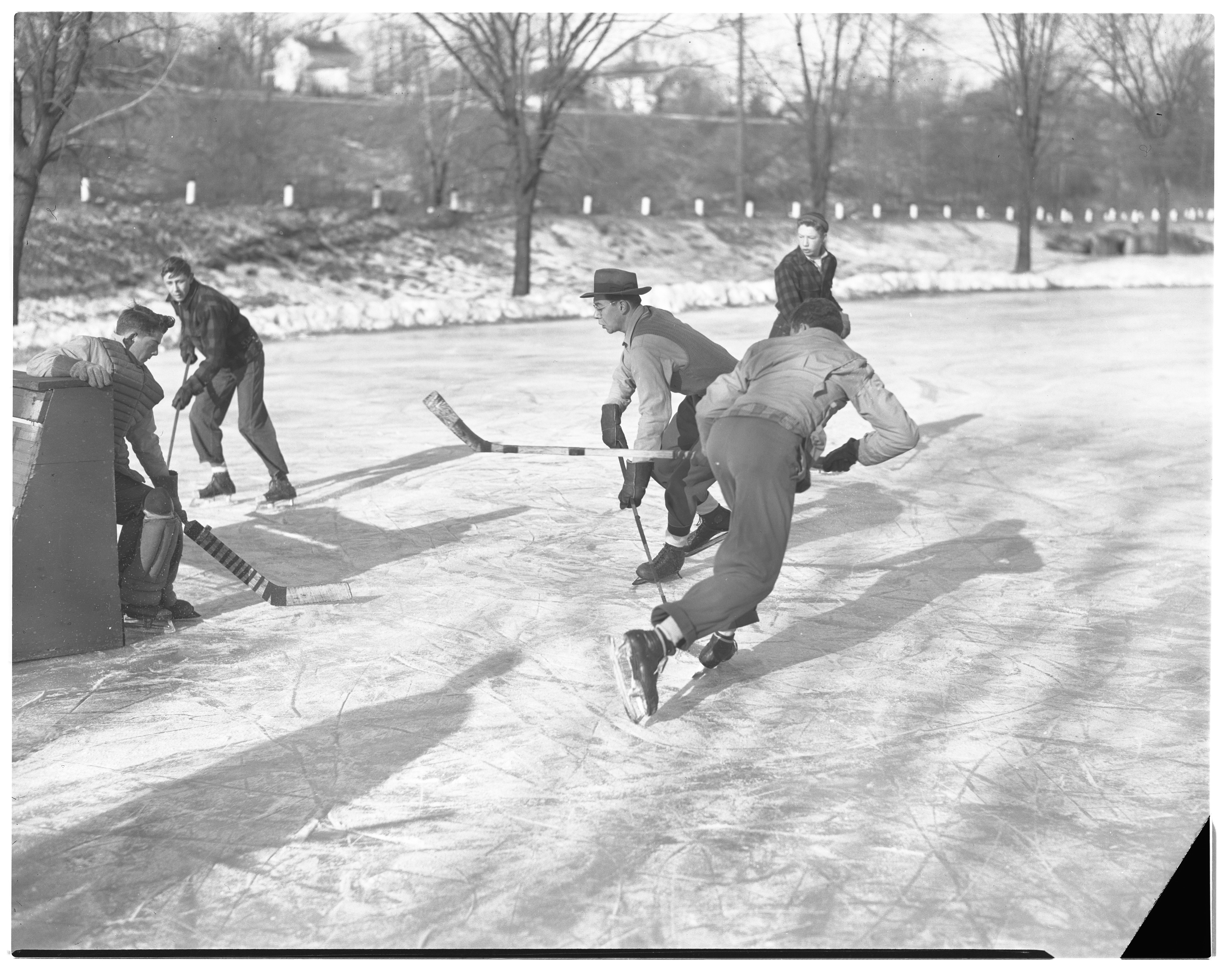 Players Enjoy Outdoor Hockey at North Side Pond, January 1947 image