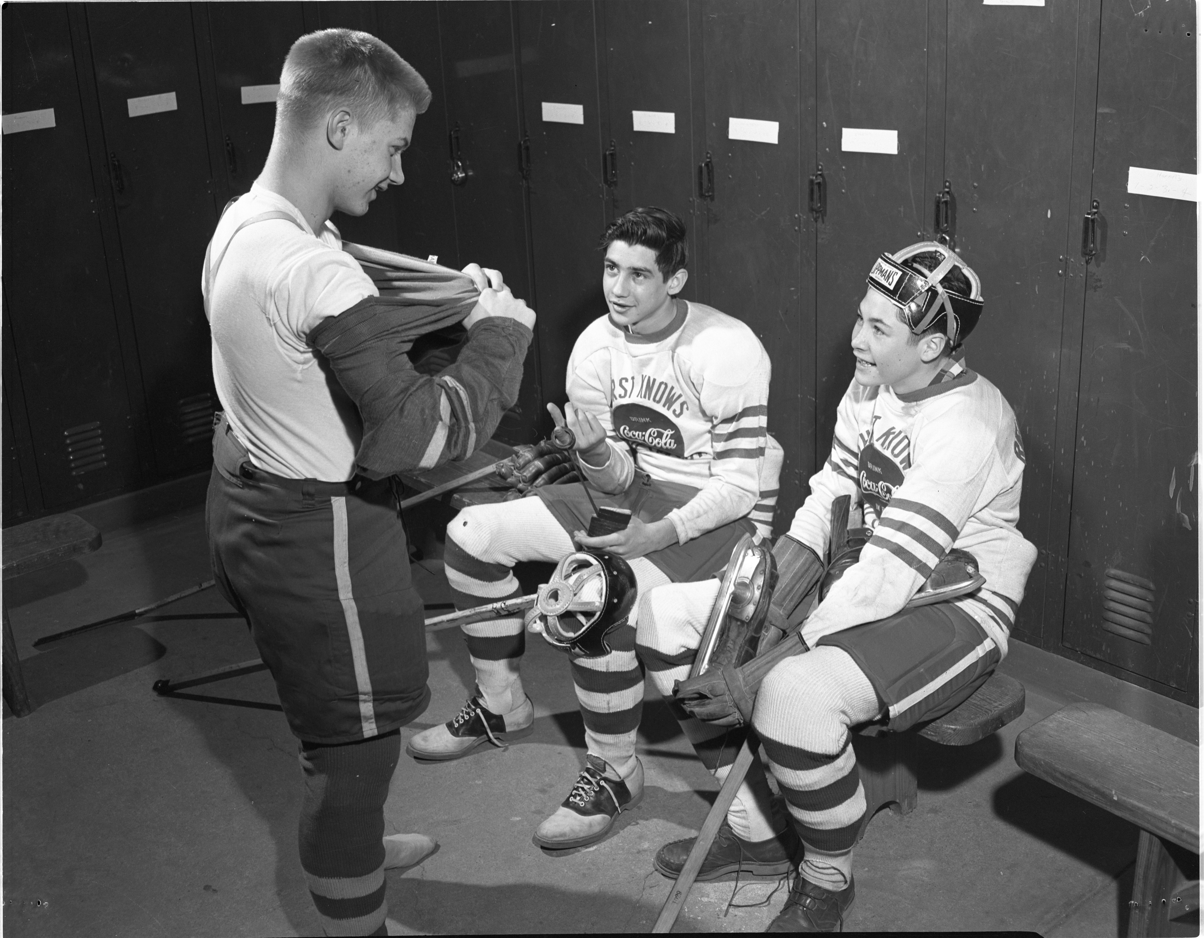 Teen Hockey Players Dress For Their Games In Wines Fieldhouse Locker Room, February 1953 image
