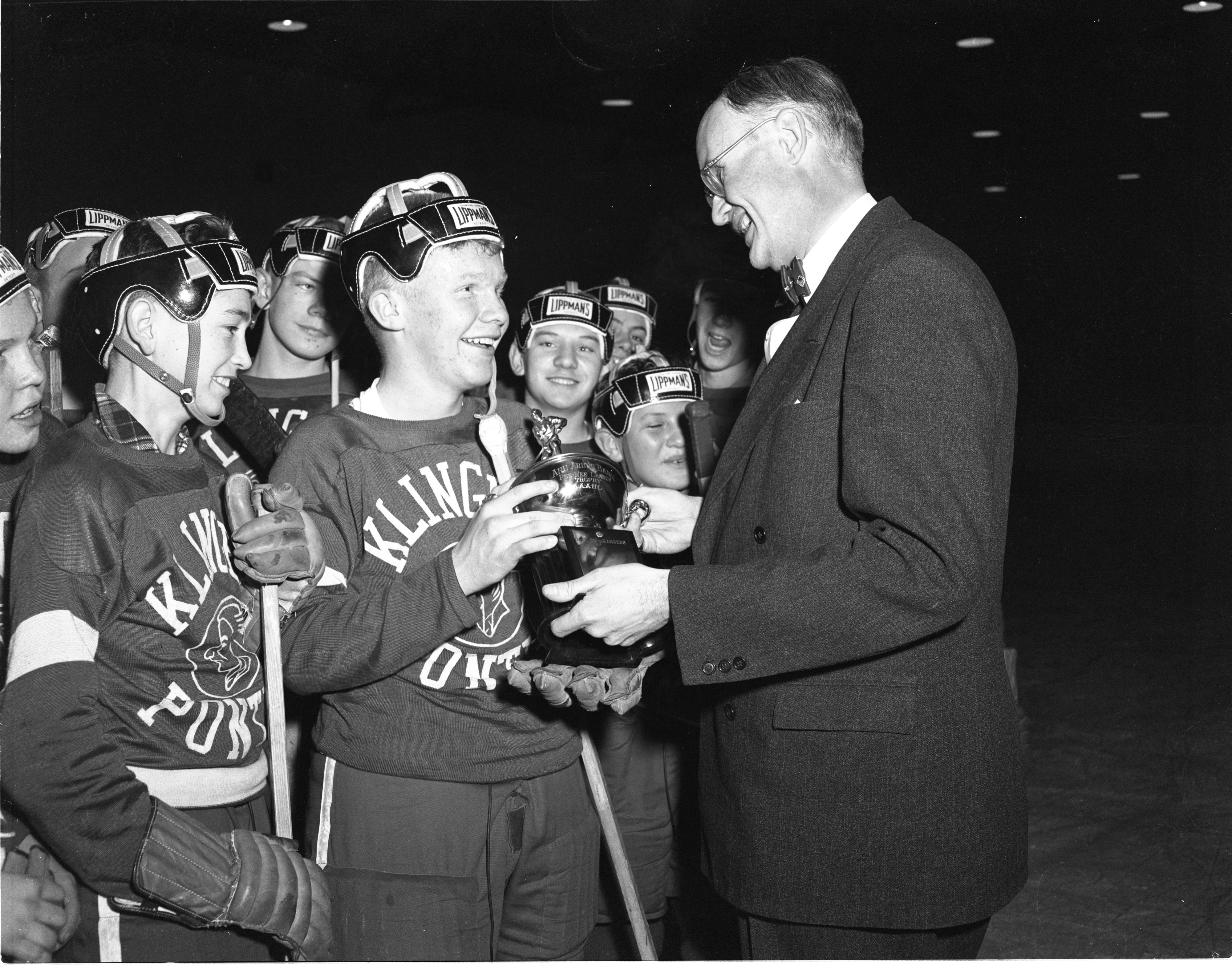 Amateur Hockey Player Dale Alexander Receives The League Championship Trophy On Behalf Of His Team, March 1953 image