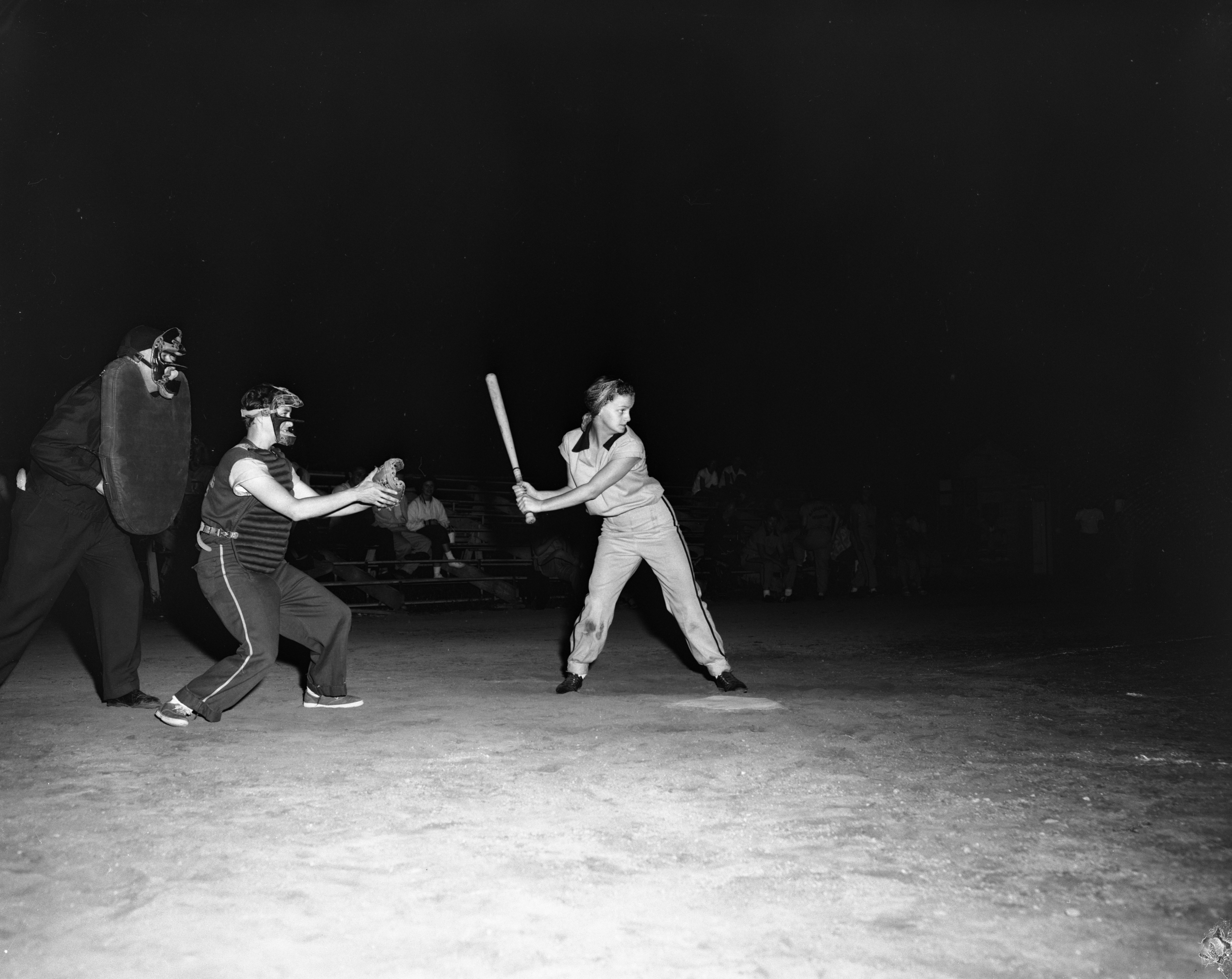 Dorleen McGuire of the Garden City players is up to bat, Women's Inter-City Softball League, Wines Field, July 1956 image