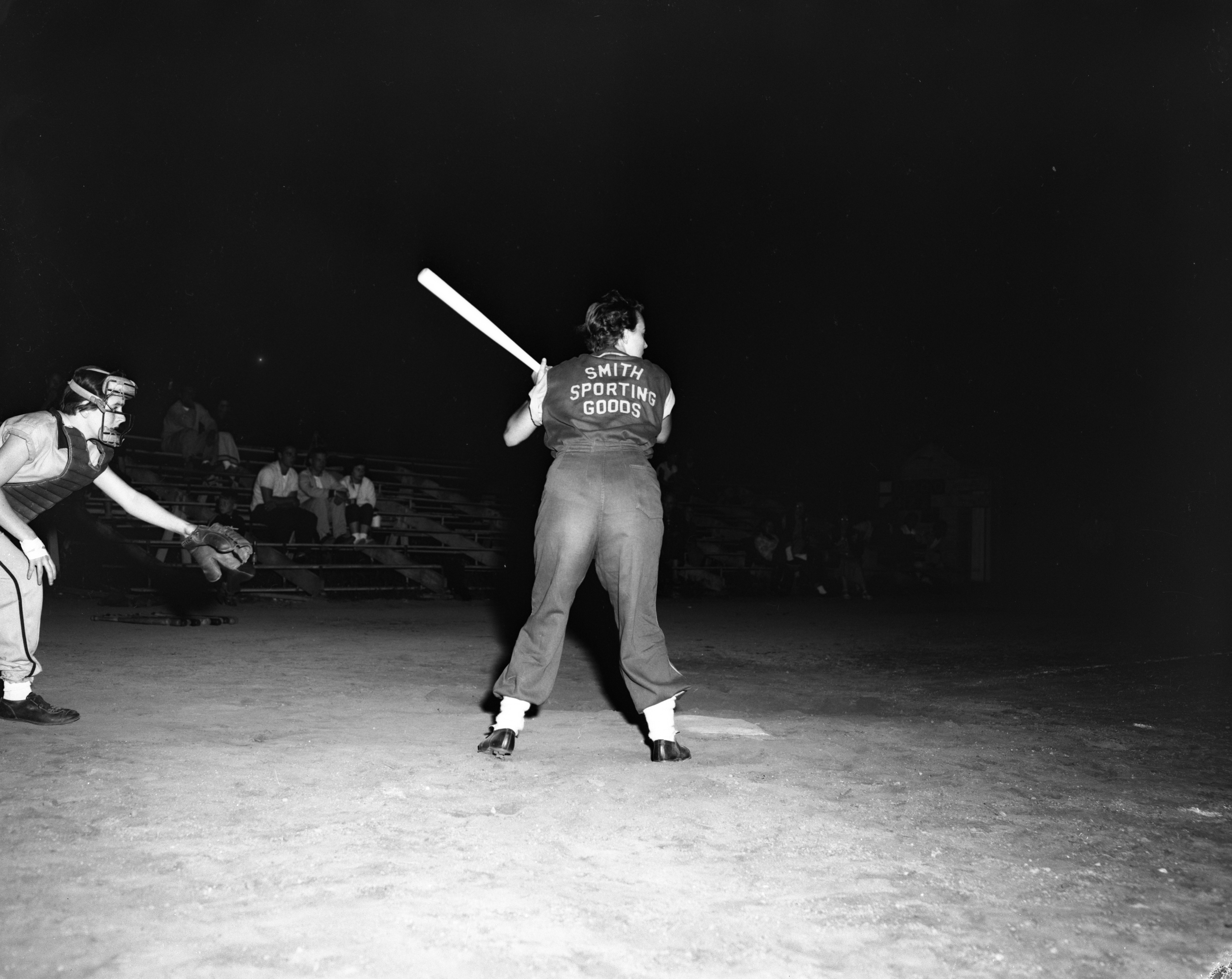 Myrt Kirbyson of the Ann Arbor Smith's up to bat, Women's Inter-City Softball League, Wines Field, July 1956	 image