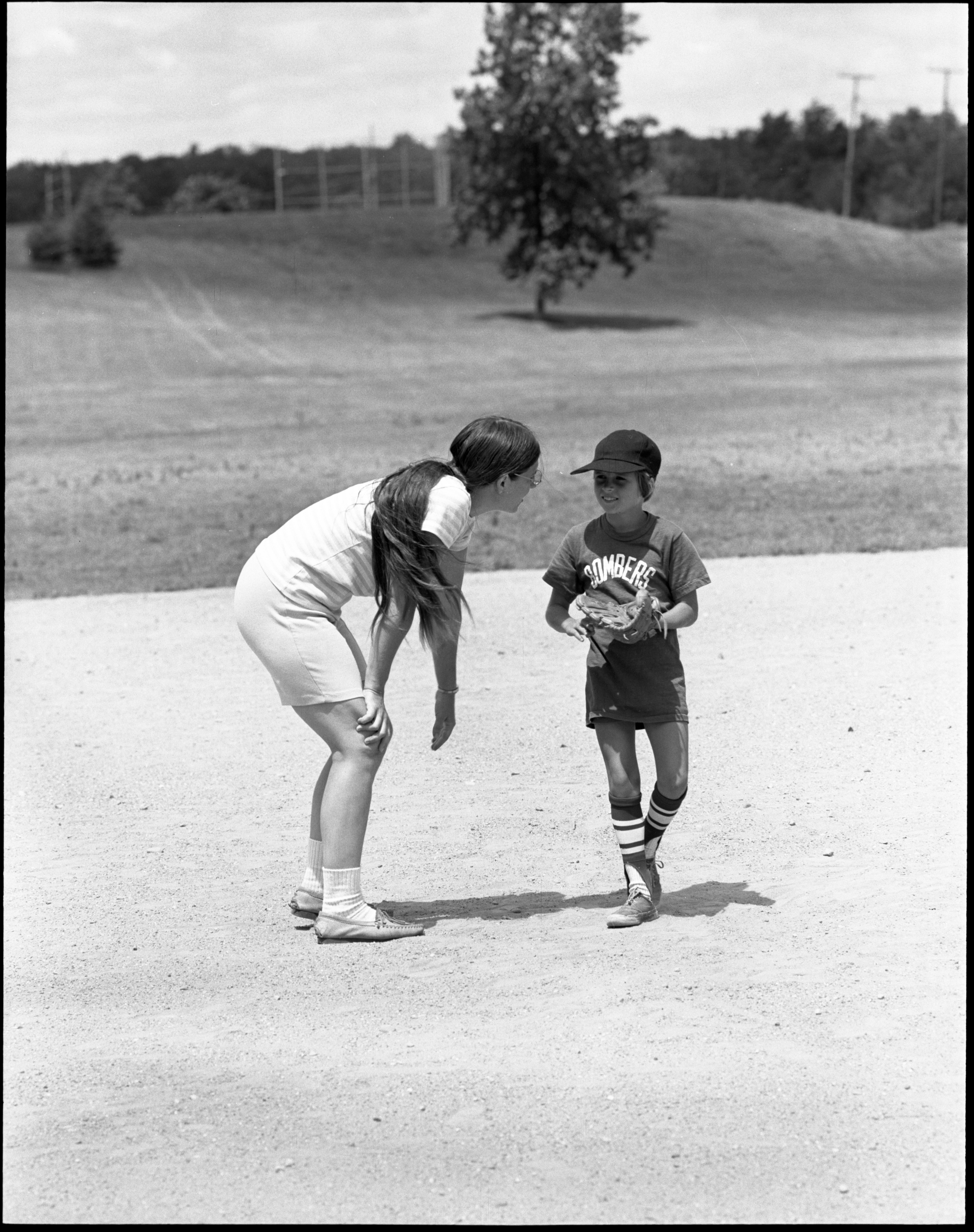 Girls Softball - Karen & Sloane Staples Chat On The Pitcher's Mound, July 1972 image