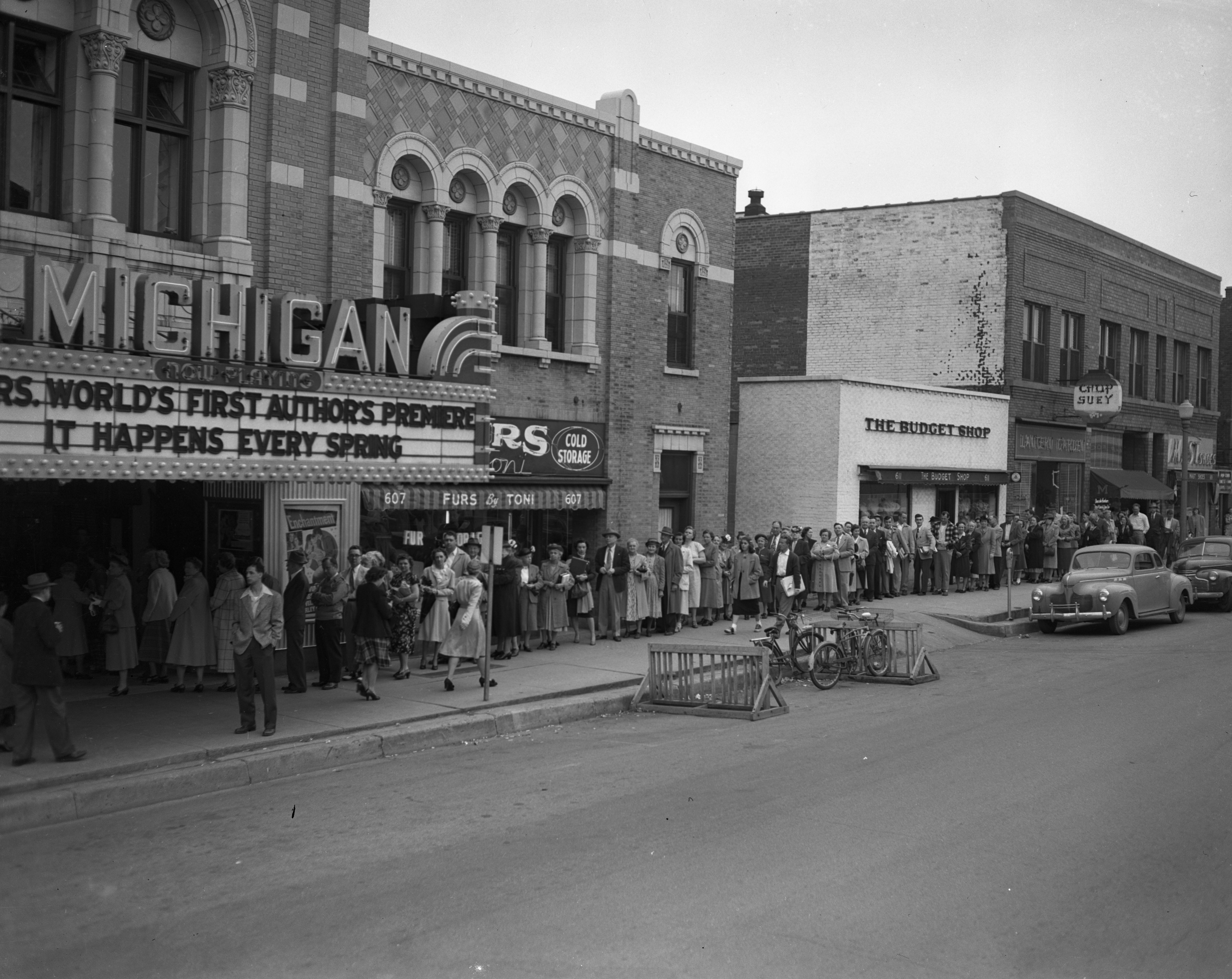 "Crowd waiting to attend the ""author's premiere"" at the Michigan Theater, May 1949 image"